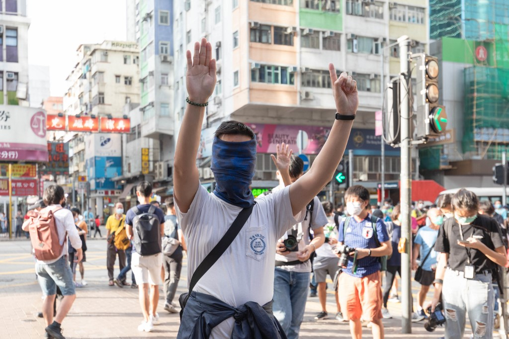 Protesters dressed in black had gathered in Mongkok, Hong Kong, on May 1, 2020 to participate in a singing protest. The city's anti-government protests return as Covid-19 cases drop.  (HW Chan/EYEPRESS)
