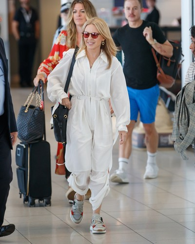 EXCLUSIVE: Kylie was all smiles on Tuesday when she departed Adelaide, The popstar took a brief moment to sign some autographs and talk to fans before being whisked away. Looking every bit the popstar, the singer was decked out in a cream jumpsuit with red tinted glasses. 12 Mar 2019, Image: 418870305, License: Rights-managed, Restrictions: World Rights, Model Release: no, Credit line: MEGA / The Mega Agency / Profimedia