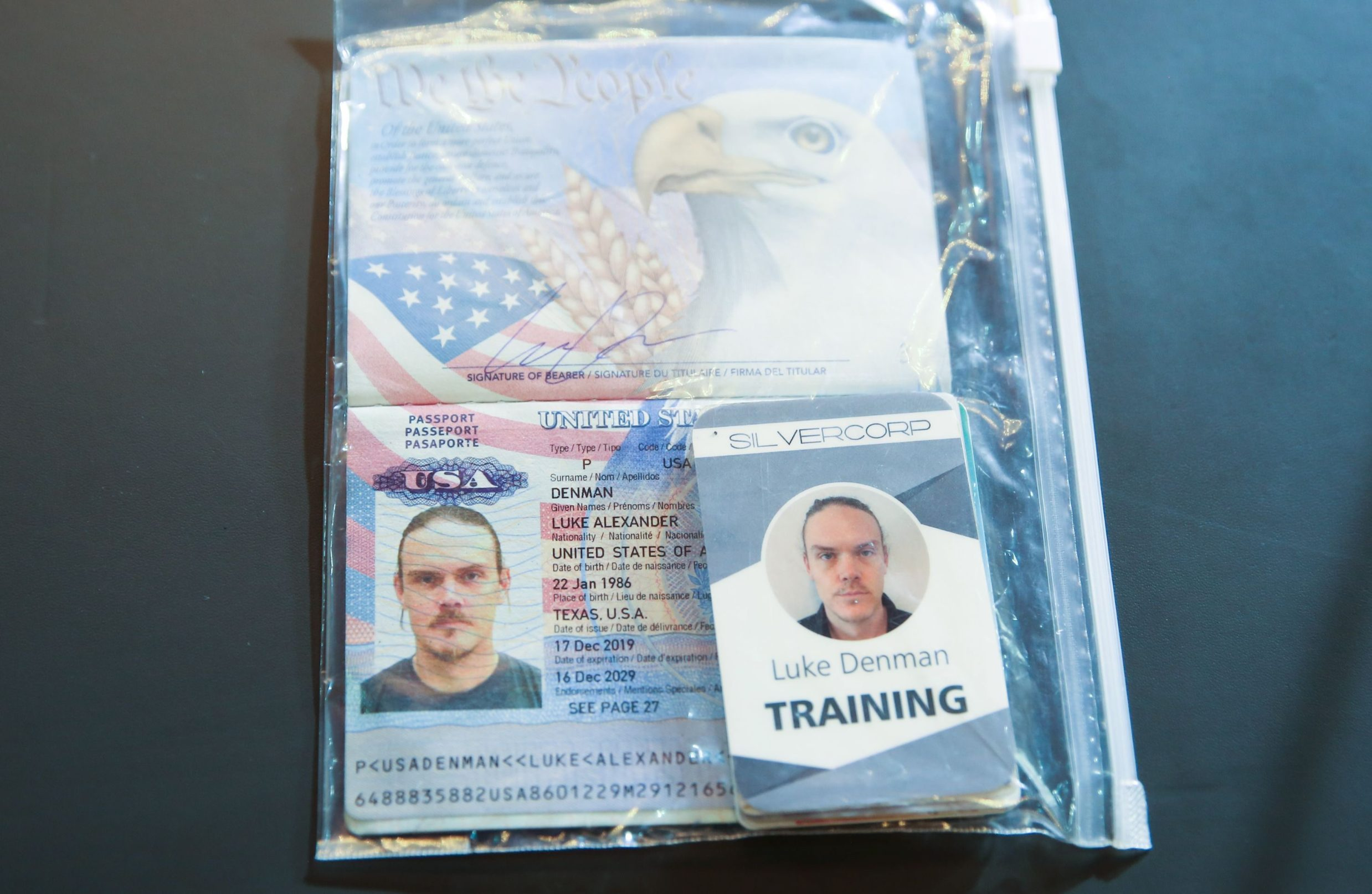 Handout picture released by the Venezuelan Presidency showing the passport of arrrested US citizen Luke Deman, during a video conference meeting with international media correspondents, at Miraflores Presidential Palace in Caracas, on May 6, 2020. - Venezuela is to try two Americans, identified as Luke Denman and Airan Berry, allegedly captured during a failed sea attack by mercenaries, President Nicolas Maduro said on May 6. (Photo by Marcelo Garcia / Venezuelan Presidency / AFP) / RESTRICTED TO EDITORIAL USE - MANDATORY CREDIT