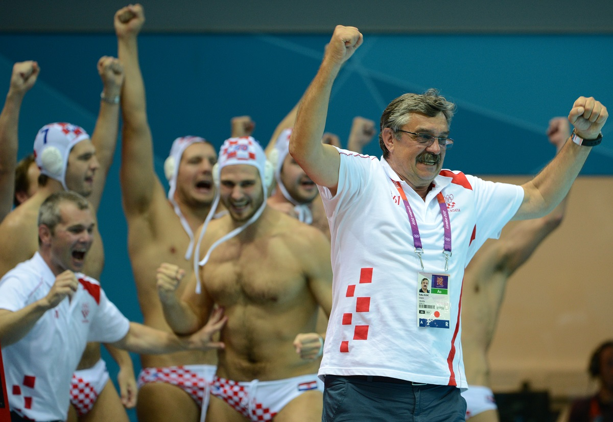 Croatia's coach Ratko Rudic (R) celebrates after the men's water polo gold medal match Croatia vs Italy at the London 2012 Olympic Games in London on August 12, 2012.      AFP PHOTO / ADEK BERRY (Photo by ADEK BERRY / AFP)
