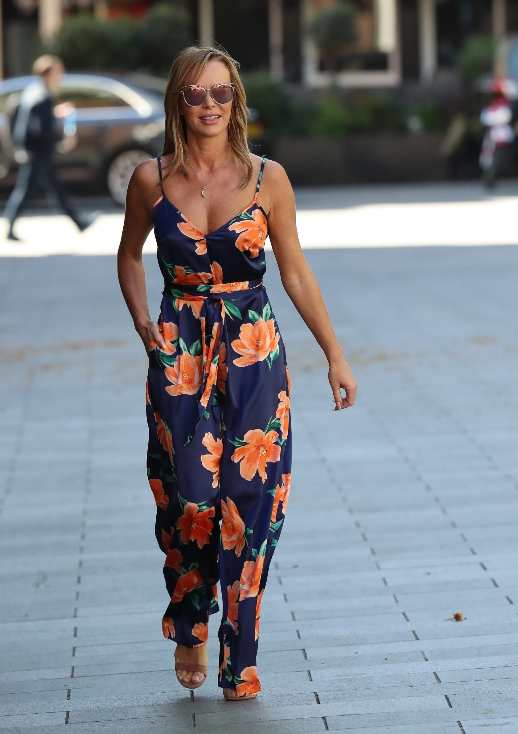London, UNITED KINGDOM  - Media personality Amanda Holden seen leaving the Global studios the Heart Radio Breakfast show wearing a gun pendant and Silk jumpsuit in London.  *UK Clients - Pictures Containing Children Please Pixelate Face Prior To Publication*, Image: 514357686, License: Rights-managed, Restrictions: , Model Release: no, Credit line: BACKGRID / Backgrid UK / Profimedia