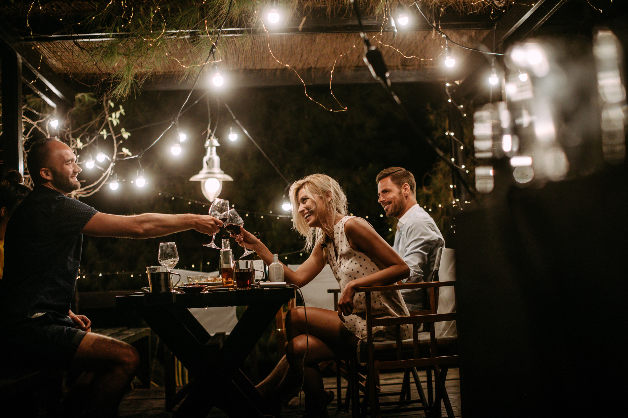 Photo of a couple having fun on a dinner party