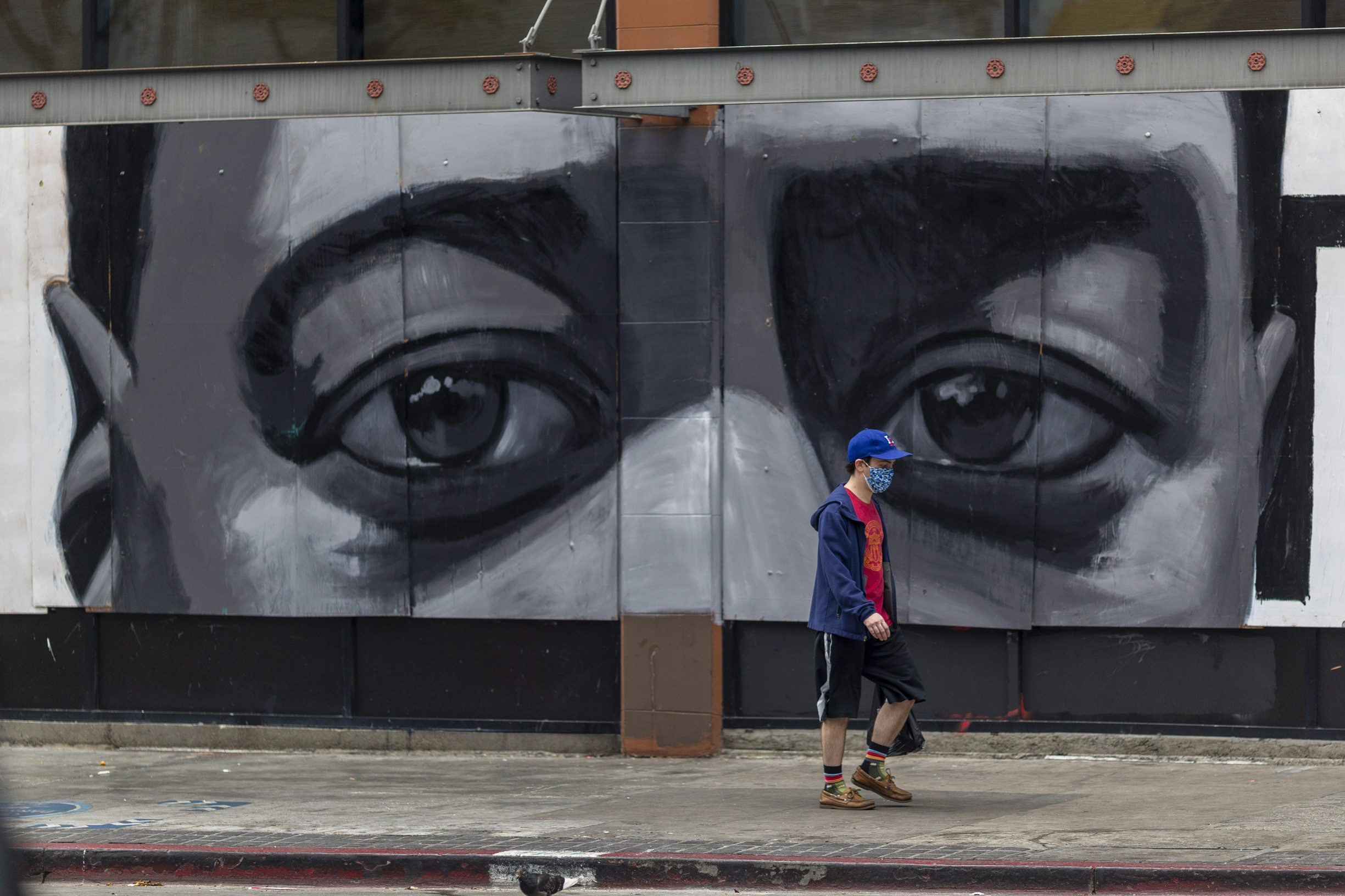 LOS ANGELES, CA - JUNE 06: A mural of a black mans eyes is seen on a downtown building as people continue to protest the killing of George Floyd despite the dangers of the widening coronavirus (COVID-19) pandemic on June 6, 2020 in Los Angeles, United States. This is the 12th day of protests since George Floyd died in Minneapolis police custody on May 25.   David McNew/Getty Images/AFP == FOR NEWSPAPERS, INTERNET, TELCOS & TELEVISION USE ONLY ==
