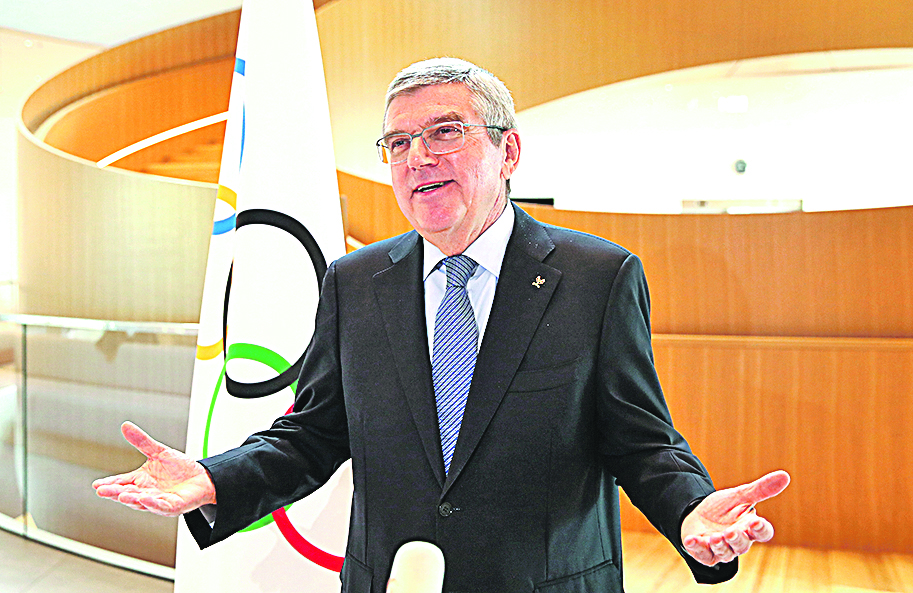 International Olympic Committee (IOC) President Thomas Bach gestures as he speaks during an interview after the historic decision to postpone the 2020 Tokyo Olympic Games due to the coronavirus pandemic, in Lausanne, Switzerland, on March 25, 2020. - Olympic chief Bach says