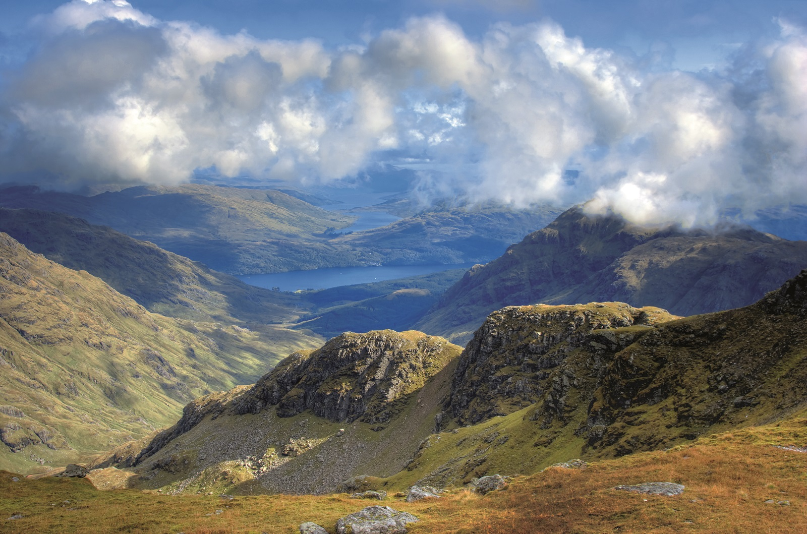 Looking from the summit of Ben Ime down through the clouds to Loch Lomond, Loch Arklet and Loch Katrine.