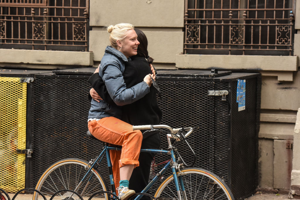 NEW YORK, NY - APRIL 27 : Two people embrace on the street on April 27, 2020 in the Brooklyn borough of New York City. Due to social distancing guidelines most residents remain in home quarantine. (Photo by Stephanie Keith/Getty Images)