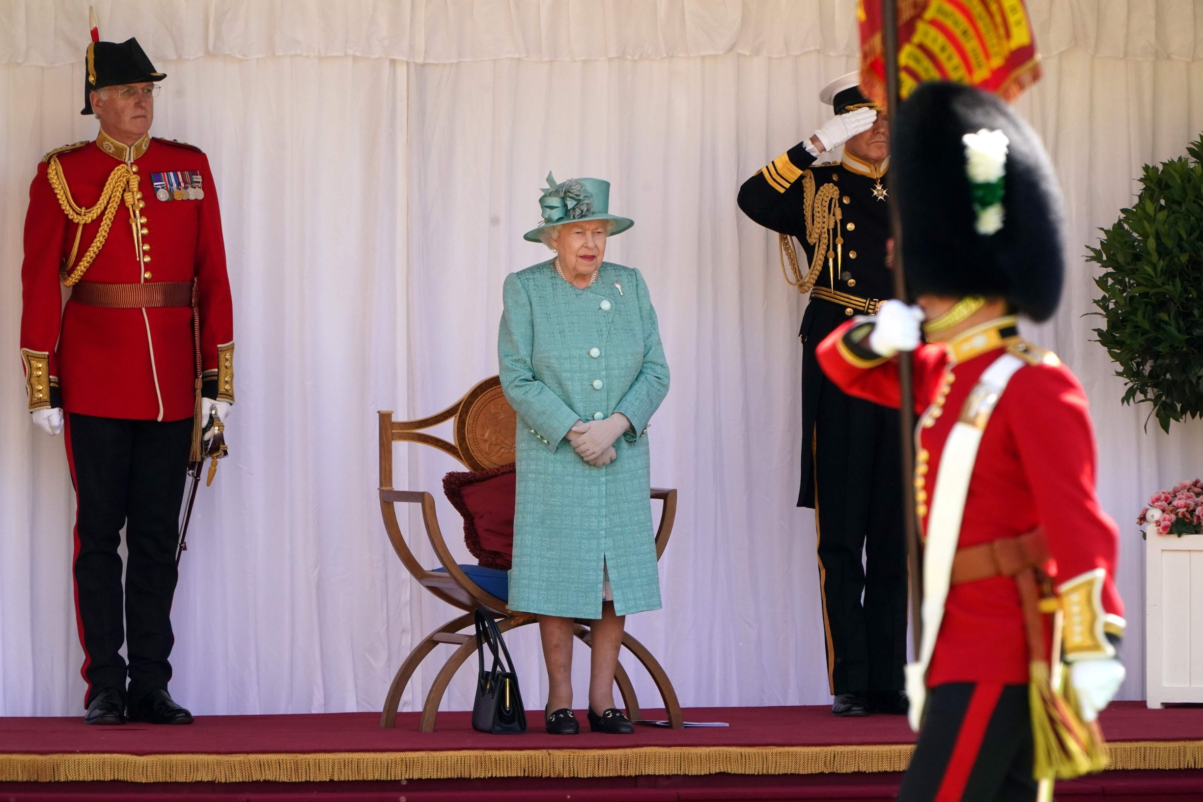 Britain's Queen Elizabeth II attends a ceremony to mark her official birthday at Windsor Castle in Windsor, southeast England on June 13, 2020, as Britain's Queen Elizabeth II celebrates her 94th birthday this year. (Photo by Paul EDWARDS / POOL / AFP)