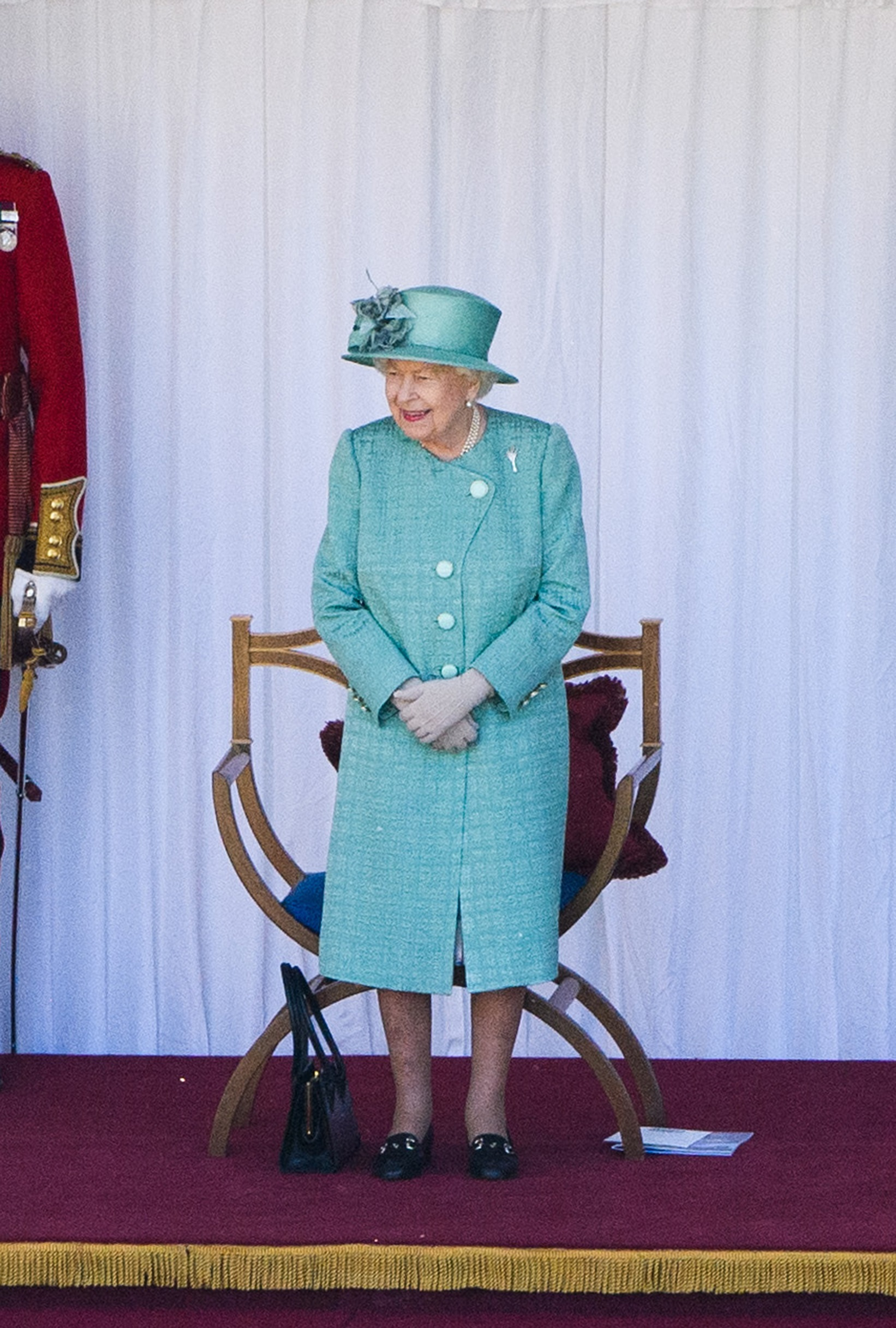 WINDSOR, ENGLAND - JUNE 13:  Queen Elizabeth II attends a ceremony to mark her official birthday at Windsor Castle on June 13, 2020 in Windsor, England. The Queen celebrates her 94th birthday this year, in line with Government advice, it was agreed that The Queen's Birthday Parade, also known as Trooping the Colour, would not go ahead in its traditional form. (Photo by Joanne Davidson - Pool/Getty Images)