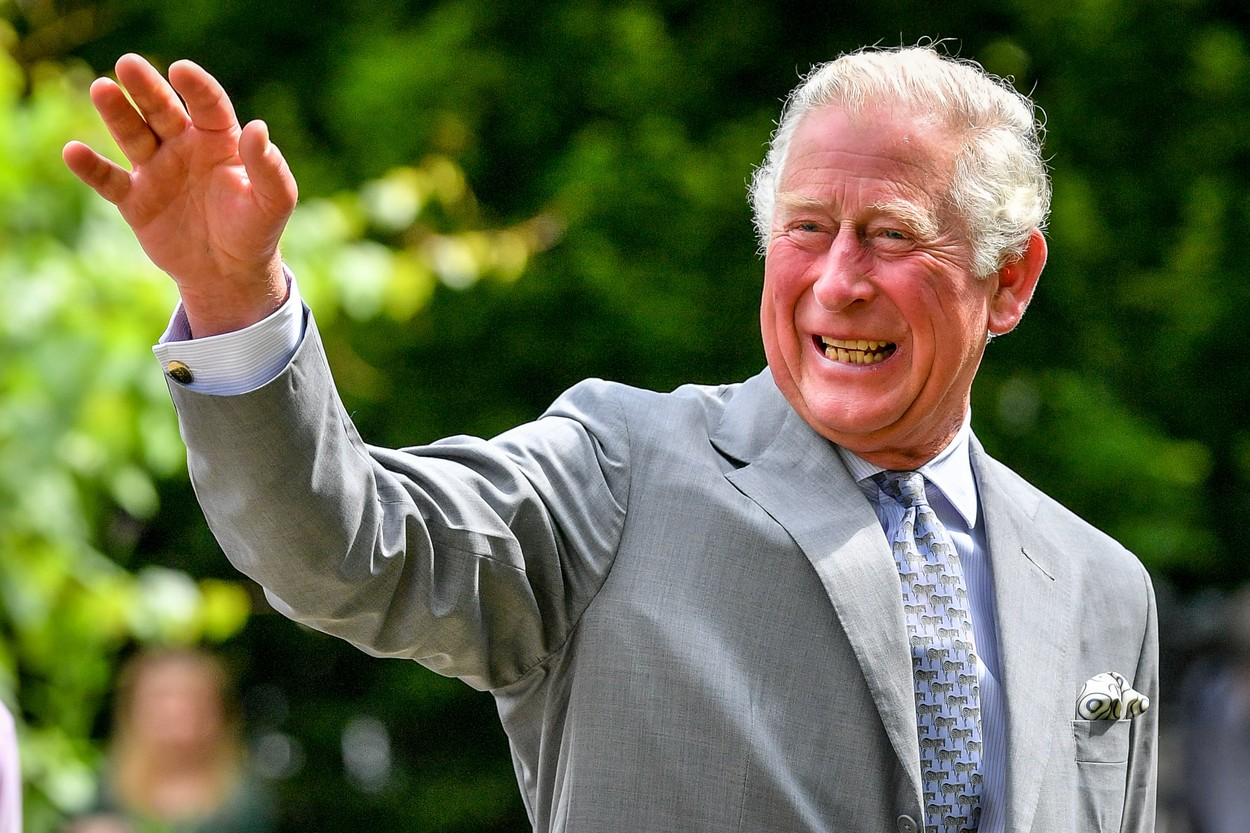 The Prince of Wales gestures to crowds of hospital staff watching from a distance as he chats with front line key workers who who have responded to the COVID-19 pandemic during a visit to Gloucestershire Royal Hospital.,Image: 532198938, License: Rights-managed, Restrictions: , Model Release: no, Credit line: Ben Birchall / PA Images / Profimedia