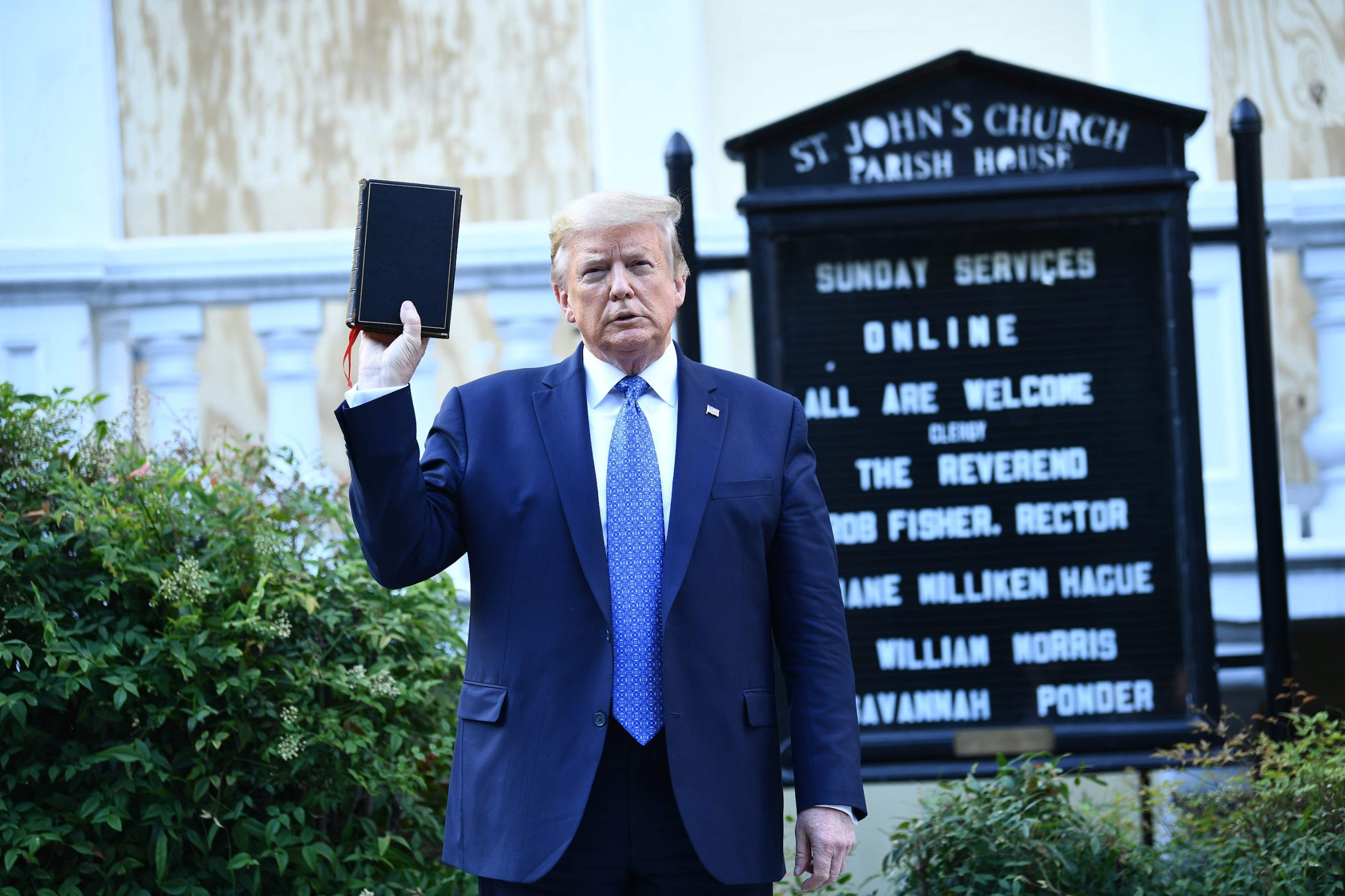 US President Donald Trump holds up a bible in front of St John's Episcopal church after walking across Lafayette Park from the White House in Washington, DC on June 1, 2020. - US President Donald Trump was due to make a televised address to the nation on Monday after days of anti-racism protests against police brutality that have erupted into violence. The White House announced that the president would make remarks imminently after he has been criticized for not publicly addressing in the crisis in recent days. (Photo by Brendan Smialowski / AFP) / ALTERNATE CROP