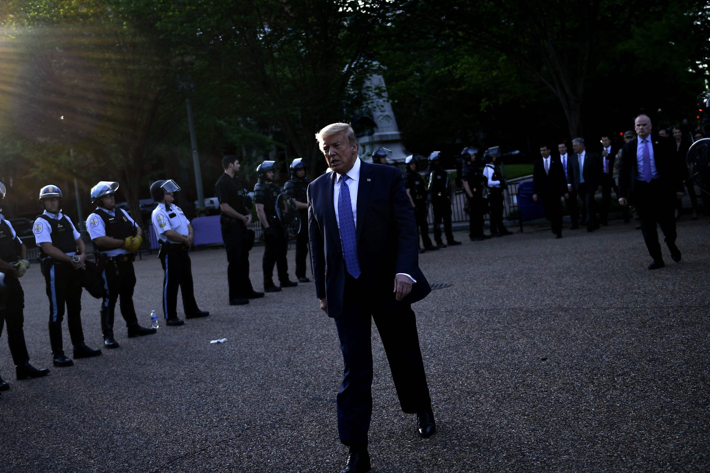 US President Donald Trump walks back to the White House escorted by the Secret Service after appearing outside of St John's Episcopal church across Lafayette Park in Washington, DC on June 1, 2020. - US President Donald Trump was due to make a televised address to the nation on Monday after days of anti-racism protests against police brutality that have erupted into violence. The White House announced that the president would make remarks imminently after he has been criticized for not publicly addressing in the crisis in recent days. (Photo by Brendan Smialowski / AFP)