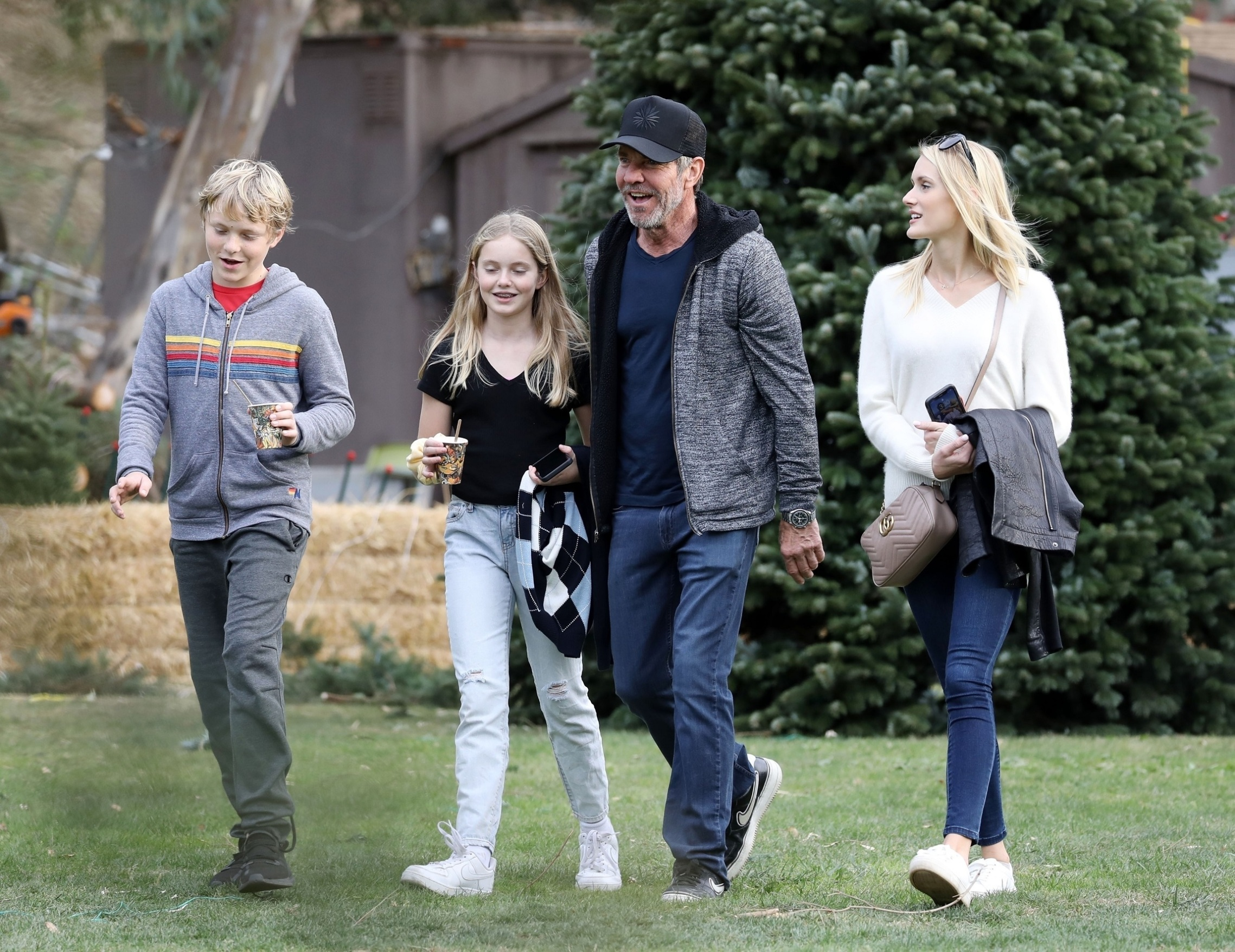 Pacific Palisades, CA  - *EXCLUSIVE*  - Dennis Quaid and his fiancée Laura Savoie go Christmas tree shopping with his two kids, Zoe and Thomas. The 'Midway' actor got into the holiday spirit, smiling and sticking his head into a snowman cutout for a photo op with his kids.  BACKGRID USA 1 DECEMBER 2019,Image: 485868582, License: Rights-managed, Restrictions: , Model Release: no, Credit line: Clint Brewer / BACKGRID / Backgrid USA / Profimedia
