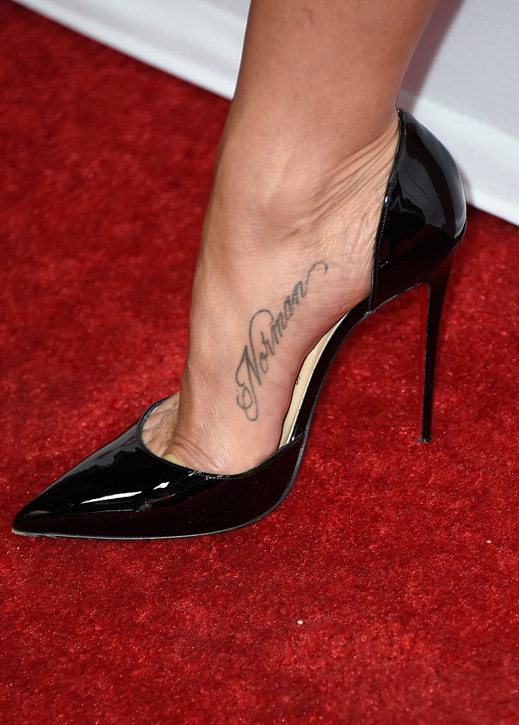 HOLLYWOOD, CA - JANUARY 14:  Actress/Producer Jennifer Aniston (shoe and tattoo detail) attends the premiere of Cinelou Films'