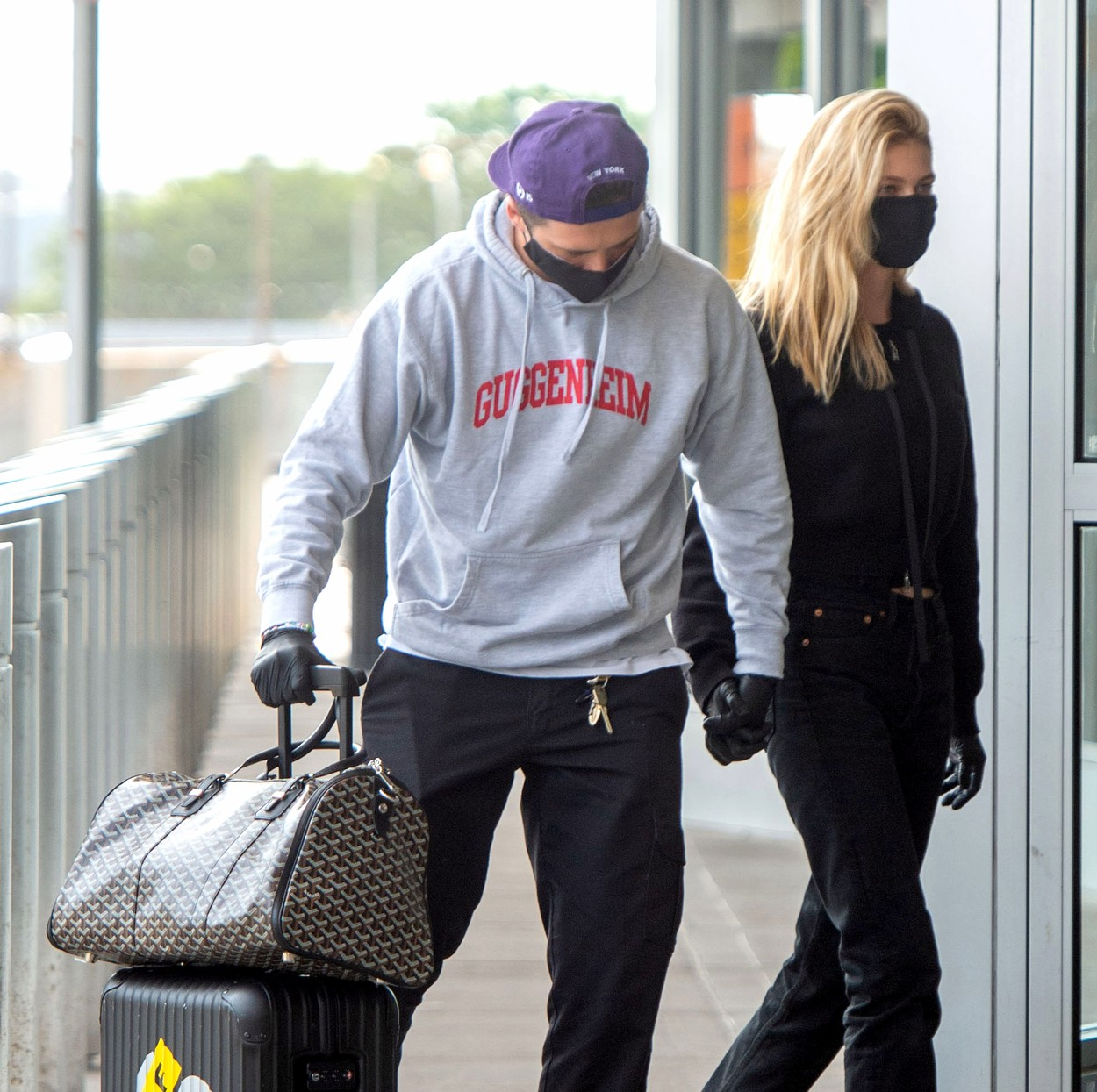 06/25/2020 EXCLUSIVE: Brooklyn Beckham with girlfriend Nicola Peltz arrive at JFK Airport in New York City to catch a flight out. The inseparable couple were pictured with an array of high end luggage including a Chanel quilted bag, Goyard duffle bag, and a Supreme suitcase. Nicola, 25, wore a black hoodie, matching Levi jeans, and chunky Prada boots. **VIDEO AVAILABLE**,Image: 536055119, License: Rights-managed, Restrictions: Exclusive NO usage without agreed price and terms. Please contact sales@theimagedirect.com, Model Release: no, Credit line: TheImageDirect.com / The Image Direct / Profimedia