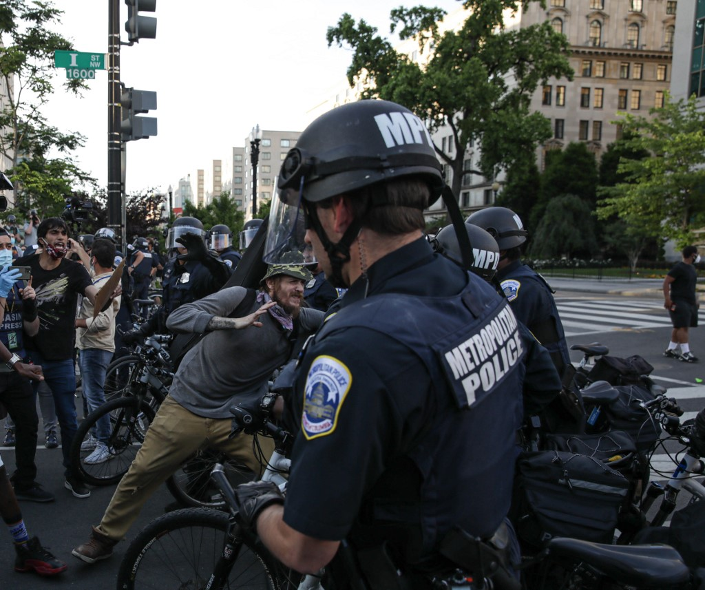 WASHINGTON, USA - JUNE 2: Security forces block the road as protesters gather near Lafayette Park ahead of President Trump's trip to St. John's Church in Washington, United States on June 2, 2020. Protests and riots continue in cities across US following the death of George Floyd, an unarmed black man who died after being pinned down by a white police officer. Yasin Ozturk / Anadolu Agency