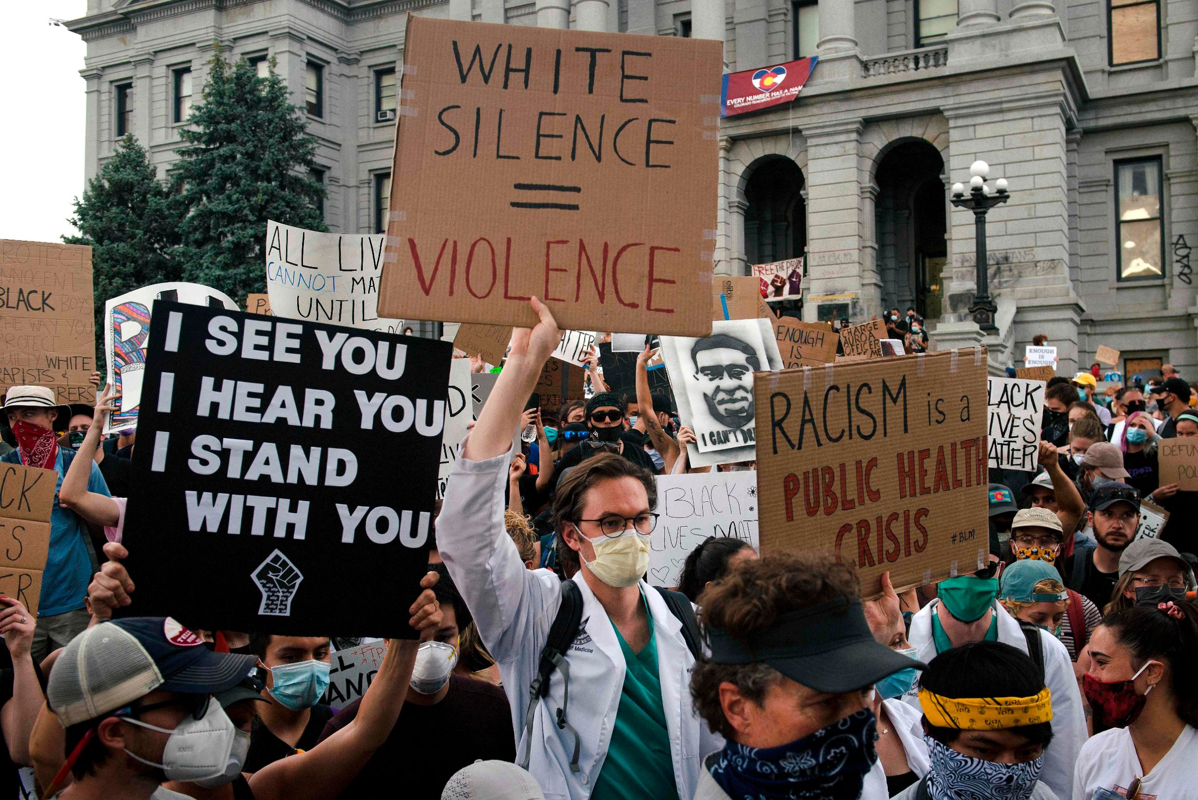 Demonstrators march in Denver, Colorado on June 3, 2020, while protesting the death of George Floyd, an unarmed black man who died while while being arrested and pinned to the ground by the knee of a Minneapolis police officer. - US protesters welcomed new charges brought Wednesday against Minneapolis officers in the killing of African American man George Floyd -- but thousands still marched in cities across the country for a ninth straight night, chanting against racism and police brutality. (Photo by Jason Connolly / AFP)