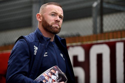 LONDON, UNITED KINGDOM  - Footballer, Wayne Rooney 34 carrying a customised washbag with his sons Kai, Ten,  Klay, six, Kit, three, and Cass, 23 months on it as he arrived in London ahead of a match.  *UK Clients - Pictures Containing Children Please Pixelate Face Prior To Publication*,Image: 491270186, License: Rights-managed, Restrictions: , Model Release: no