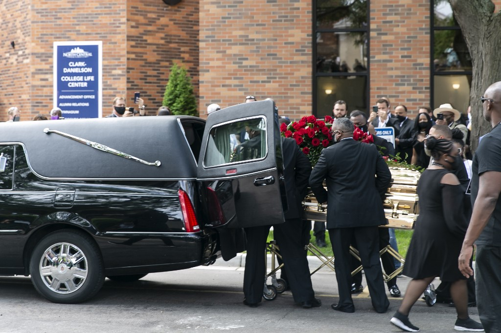 MINNEAPOLIS, USA - JUNE 04: George Floyd's casket is wheeled to a hearse after the first of three memorial services for him on June 4, 2020 at Trask Worship Center at North Central University in Minneapolis, Minnesota, United States. Hundreds of mourners Thursday attended the first of several memorials for George Floyd – an unarmed, handcuffed black man who was killed in police custody late last month. The service at North Central University in Minneapolis, Minnesota, was attended by Floyd's family and Ben Crump, the civil rights attorney representing the family, and celebrity guests. Jordan Strowder / Anadolu Agency