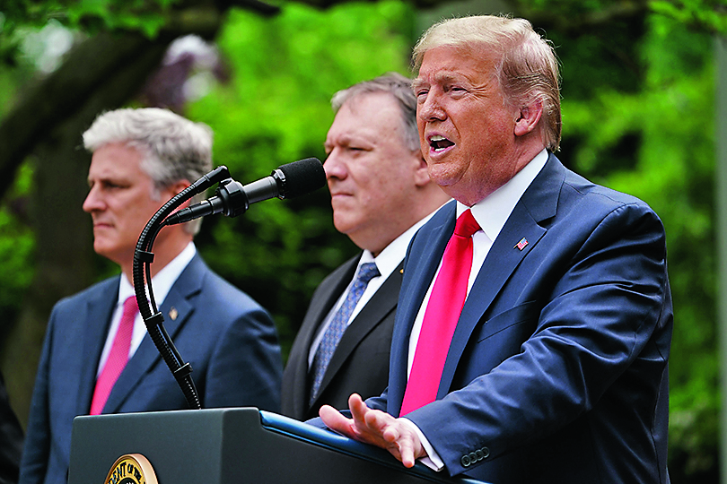 US National Security Advisor Robert O'Brien, and Secretary of State Mike Pompeo look on as US President Donald Trump speaks during a press conference on China in the Rose Garden of the White House in Washington, DC on May 29, 2020. - Trump held the press conference amid soaring tensions between the two powers, including over the status of Hong Kong and the novel coronavirus pandemic. (Photo by MANDEL NGAN / AFP)