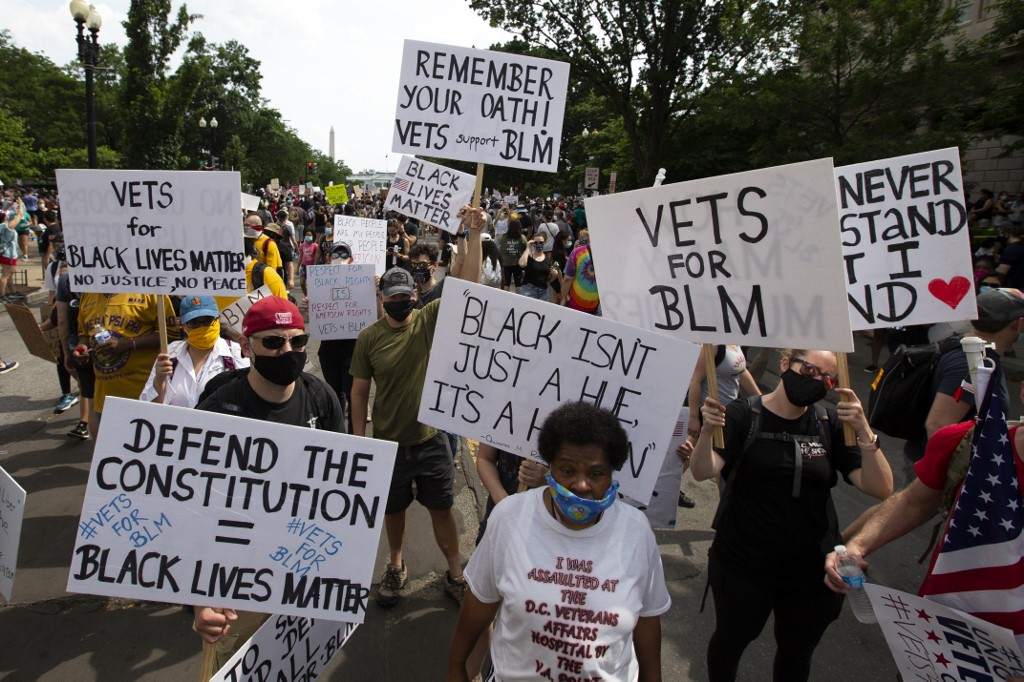 Demonstrators rally near the White House during a peaceful protest against police brutality and racism, on June 6, 2020 in Washington, DC. - Demonstrations are being held across the US following the death of George Floyd on May 25, 2020, while being arrested in Minneapolis, Minnesota. (Photo by Jose Luis Magana / AFP)