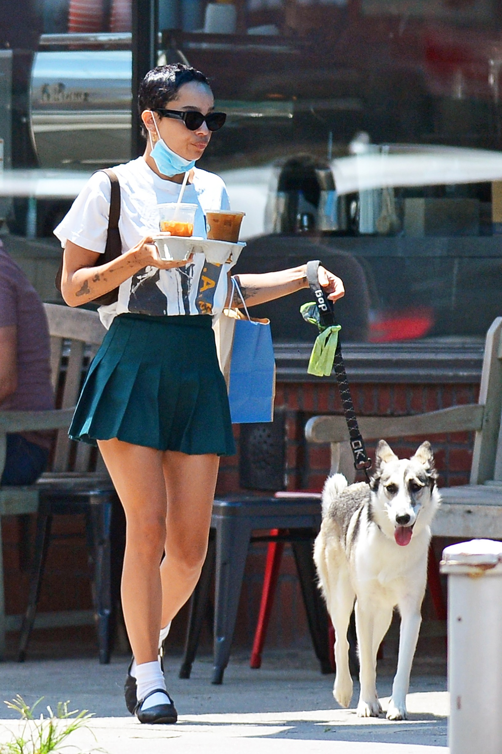 06/30/2020 EXCLUSIVE: Zoe Kravitz heads out for coffee with her dog in New York City. The 31 year old actress wore a face mask, vintage anti police t-shirt, green pleated mini skirt, white socks, and black flats.,Image: 537640083, License: Rights-managed, Restrictions: Exclusive NO usage without agreed price and terms. Please contact sales@theimagedirect.com, Model Release: no, Credit line: TheImageDirect.com / The Image Direct / Profimedia