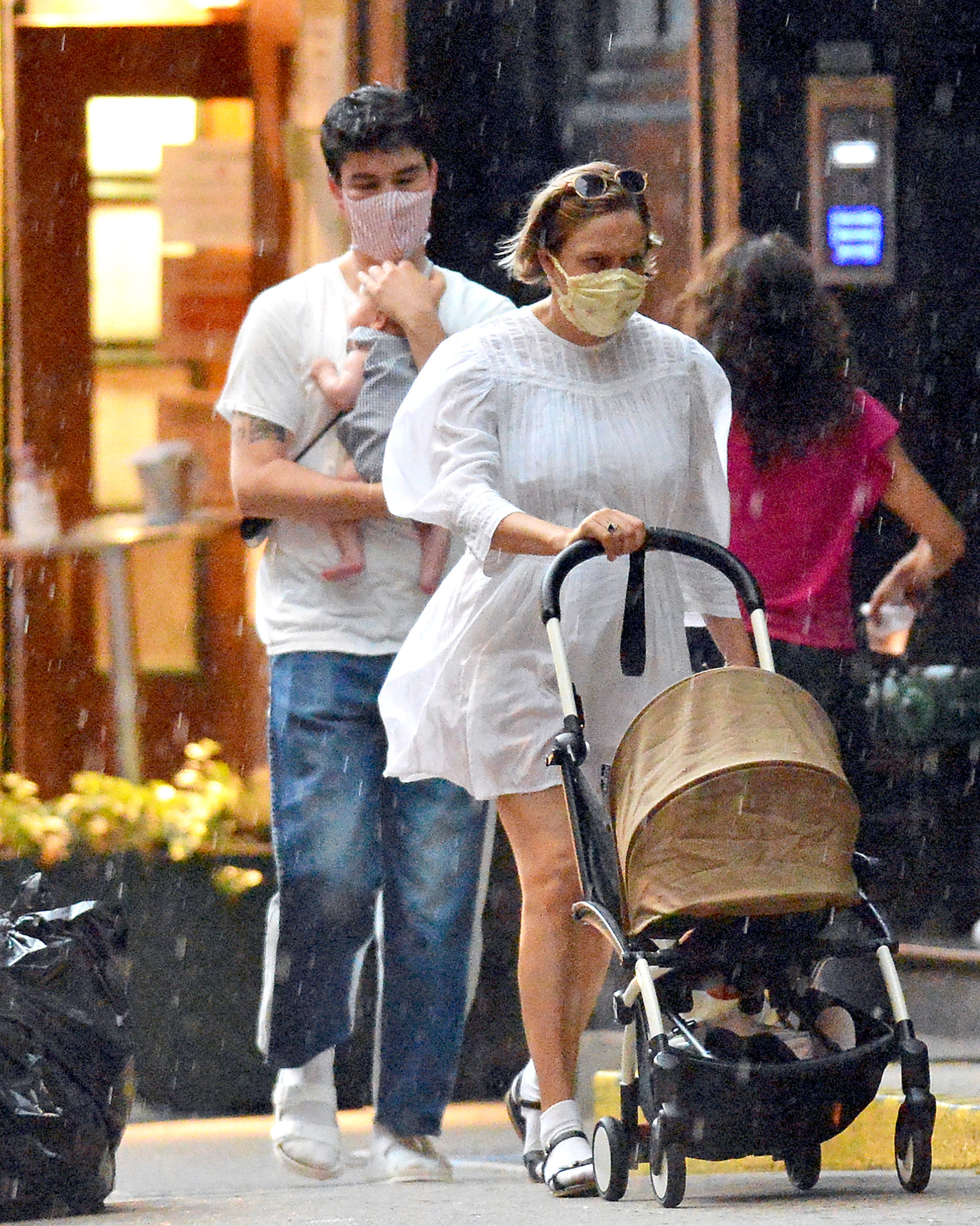 06/28/2020 EXCLUSIVE: Chloe Sevigny gets caught in a brief sun shower as she heads out with Sinisa Mackovic in New York City. The 45 year old actress flashed a ring on her left hand sparking engagement rumours. Sevigny wore a face mask, white dress, matching socks, and black sandals.,Image: 537072122, License: Rights-managed, Restrictions: Exclusive NO usage without agreed price and terms. Please contact sales@theimagedirect.com, Model Release: no, Credit line: TheImageDirect.com / The Image Direct / Profimedia