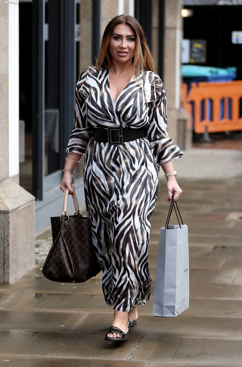 London, UNITED KINGDOM  - *EXCLUSIVE*  - Lauren Goodger is seen filming her first date for TV show Celebs Go Dating.   Lauren shows her curvy figure in a black and white maxi dress as she dates a guy called Tom. Lauren has signed up to the show to find herself a husband.  *UK Clients - Pictures Containing Children Please Pixelate Face Prior To Publication*,Image: 444165354, License: Rights-managed, Restrictions: , Model Release: no, Credit line: Cobra / BACKGRID / Backgrid UK / Profimedia