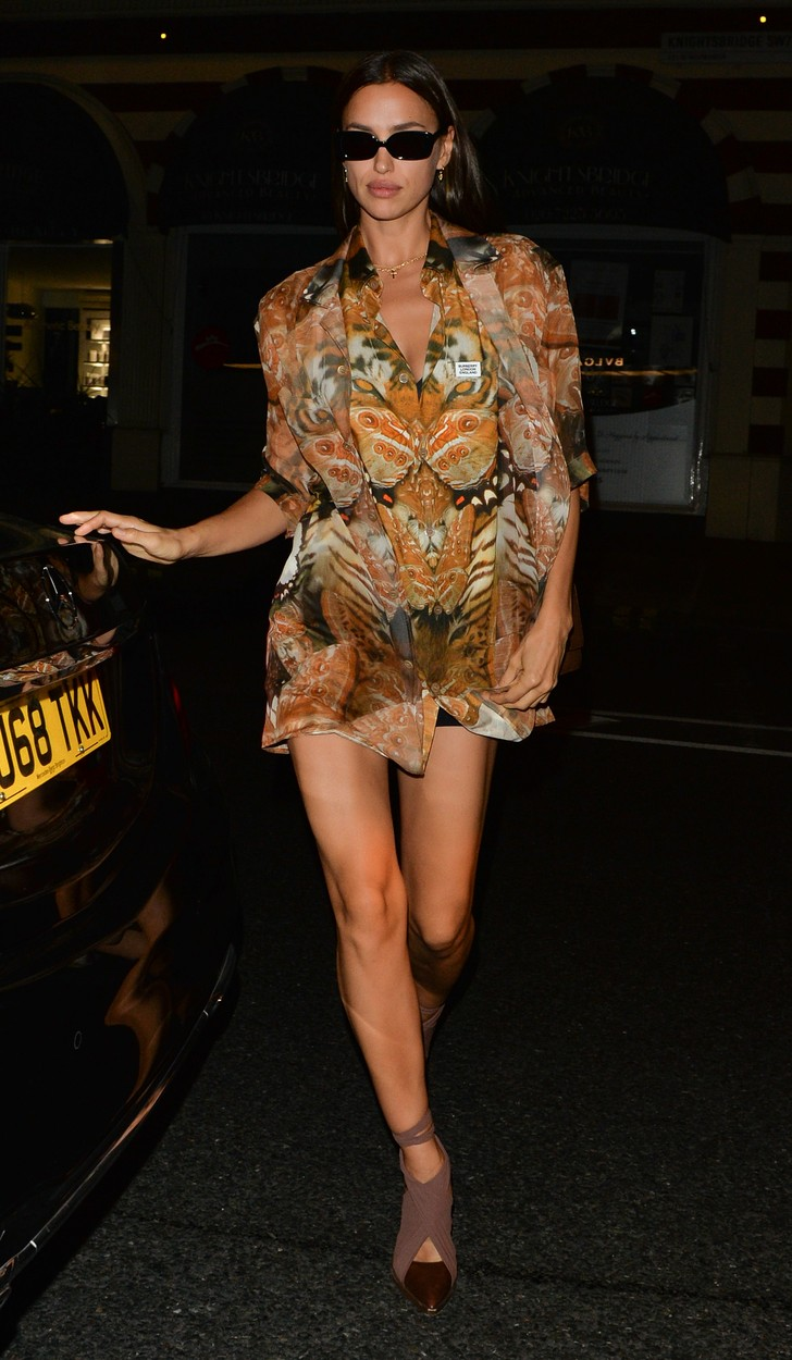 102383, Irina Shayk wears her sunglasses at night as she steps out wearing a tiger dress in London. London, UK - Monday September 16, 2019.,Image: 471258645, License: Rights-managed, Restrictions: , Model Release: no, Credit line: FlightPhotoAgency / Flight Photo Agency / Profimedia