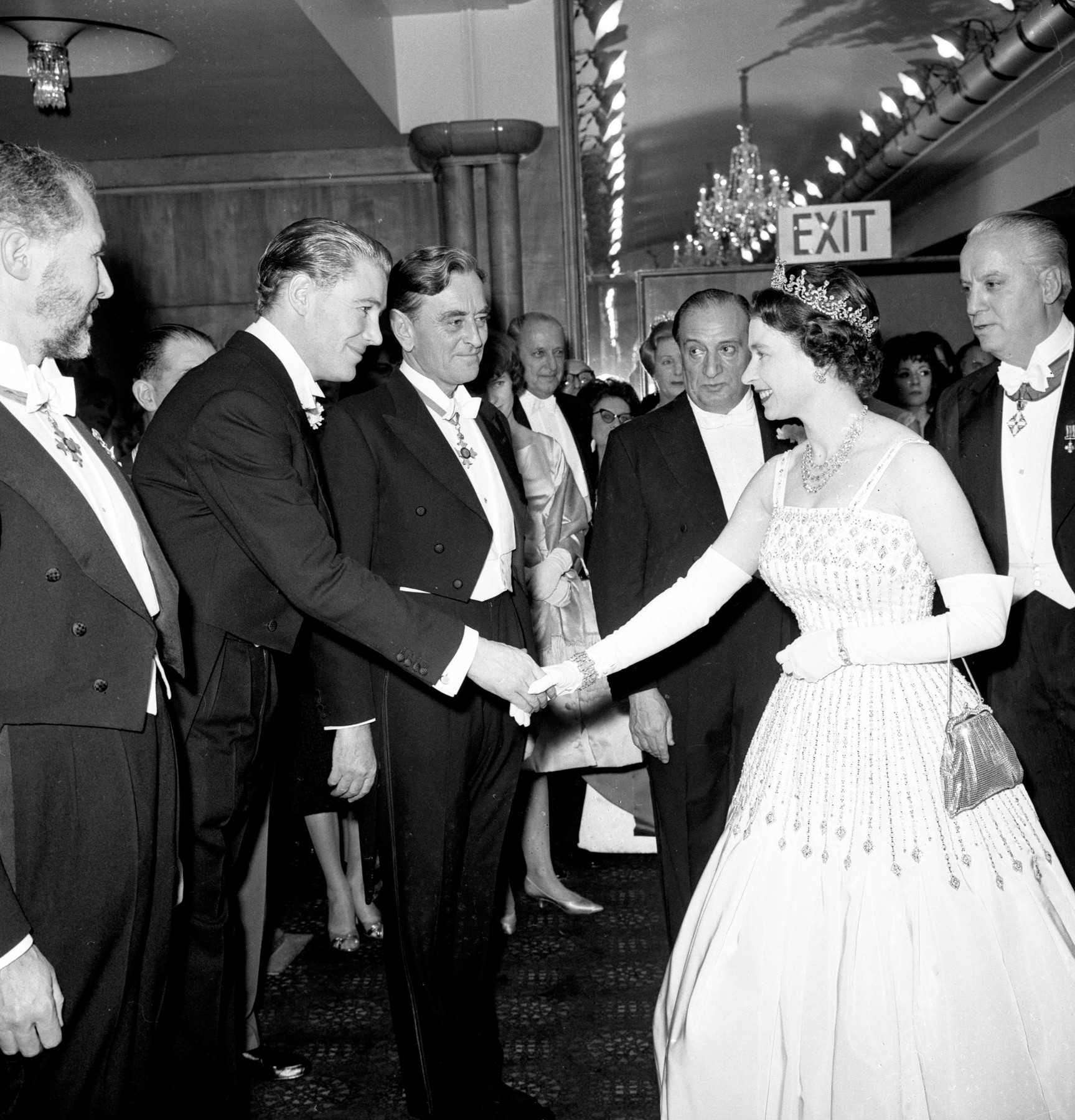 File photo dated 10/12/62 of Queen Elizabeth II arriving at the Odeon, Leicester Square, London for the world charity premiere of the film 'Lawrence of Arabia'. The Queen is wearing the same Peau De Soie taffeta dress by Norman Hartnell that was worn by Princess Beatrice at her wedding to Edoardo Mapelli Mozzi on Friday.,Image: 544663457, License: Rights-managed, Restrictions: FILE PHOTO, Model Release: no, Credit line: PA / PA Images / Profimedia