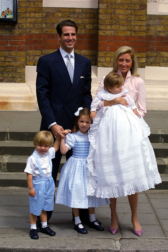 390272 12: Greece''s Crown Prince and Crown Princess Pavlos with their children, left to right, Constantine Alexiosson, Maria-Olympia, and Achileas Andraes pose for a photograph June 7, 2001 at the Greek Cathedral of Saint Sophia in London, England. (Photo by Sion Touhig/Getty Images)