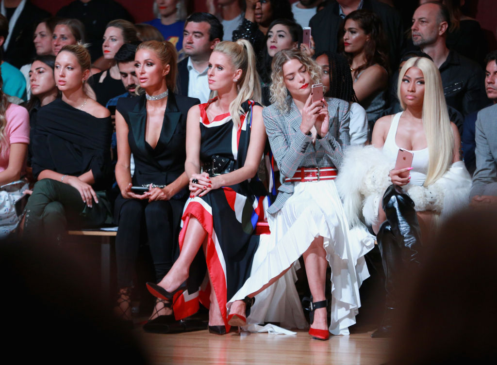 NEW YORK, NY - SEPTEMBER 08:  (L-R) Princess Olympia of Greece, Paris Hilton,Nicky Hilton Rothschild, Jaime King,and  Nicki Minaj attend the Monse fashion show during New York Fashion Week: The Shows on September 8, 2017 in New York City.  (Photo by Robin Marchant/Getty Images For NYFW: The Shows)