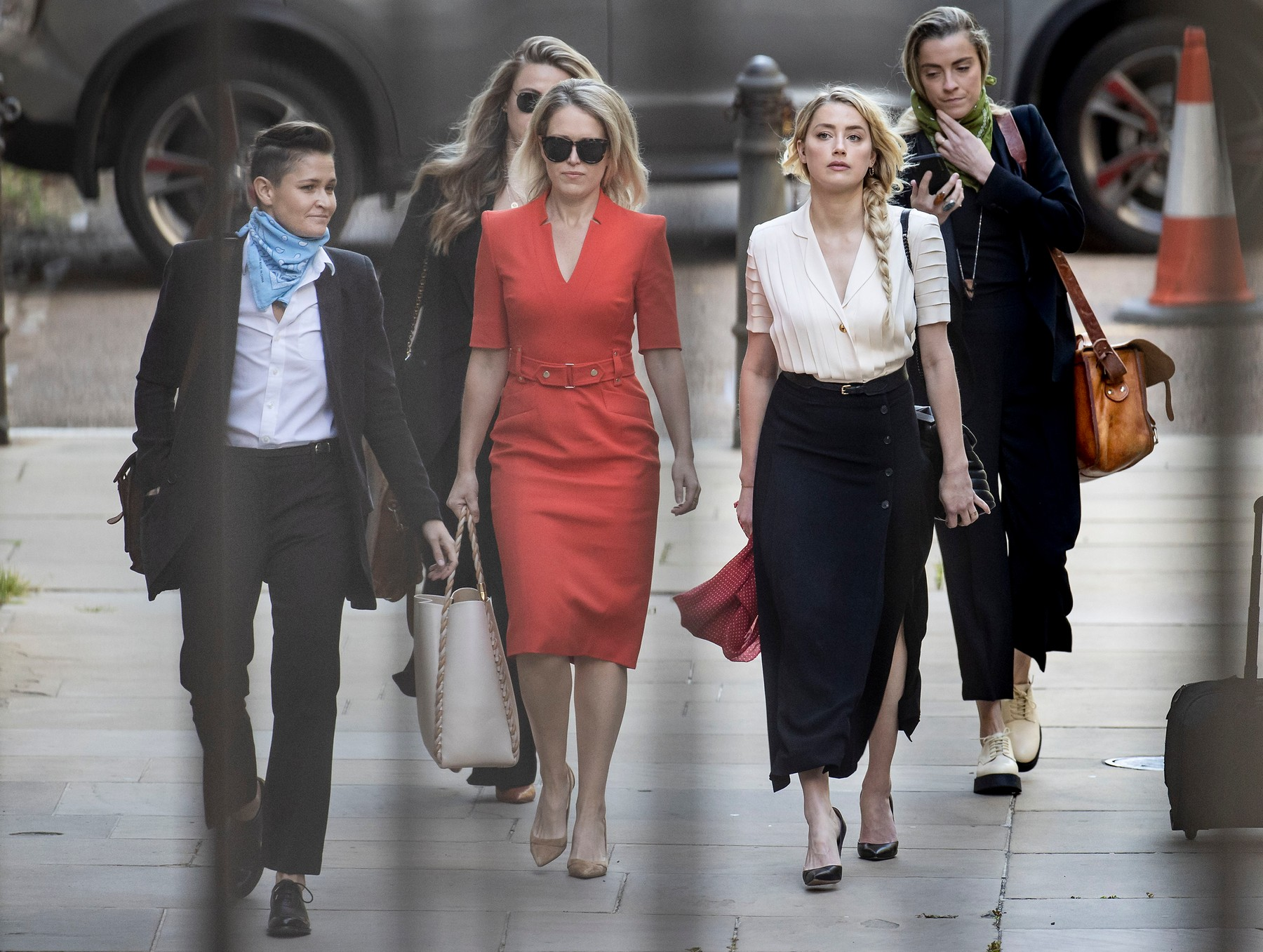 American actor AMBER HEARD (2R) arrives with girlfriend Bianca Butti (L), lawyer Jennifer Robinson (2L) and her sister Whitney Heard (R) at the High Court in London where Johnny Depp is in a legal dispute with UK tabloid newspaper The Sun over allegations he assaulted his former wife, Amber Heard.,Image: 545325083, License: Rights-managed, Restrictions: WORLDWIDE RIGHTS AVAILABLE. End users shall not licence, sell, transmit, or distribute any photographs represented by eyevine, to any third party., Model Release: no, Credit line: Peter Macdiarmid / Eyevine / Profimedia