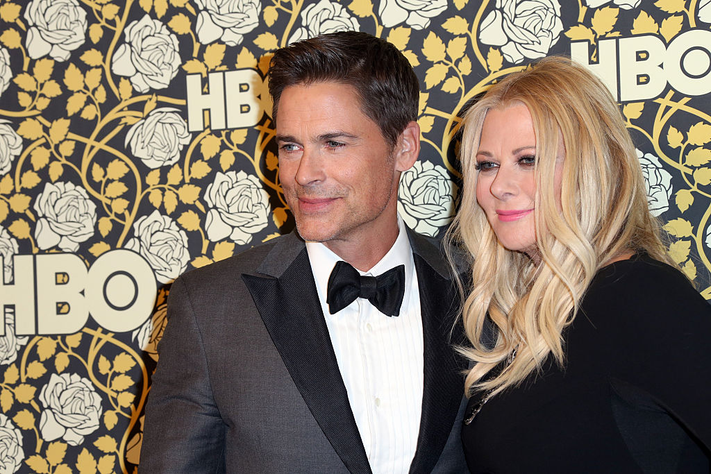 BEVERLY HILLS, CA - JANUARY 10:  Actor Rob Lowe (L) and makeup artist Sheryl Berkoff attend HBO's Post 2016 Golden Globe Awards Party at Circa 55 Restaurant on January 10, 2016 in Los Angeles, California.  (Photo by Frederick M. Brown/Getty Images)
