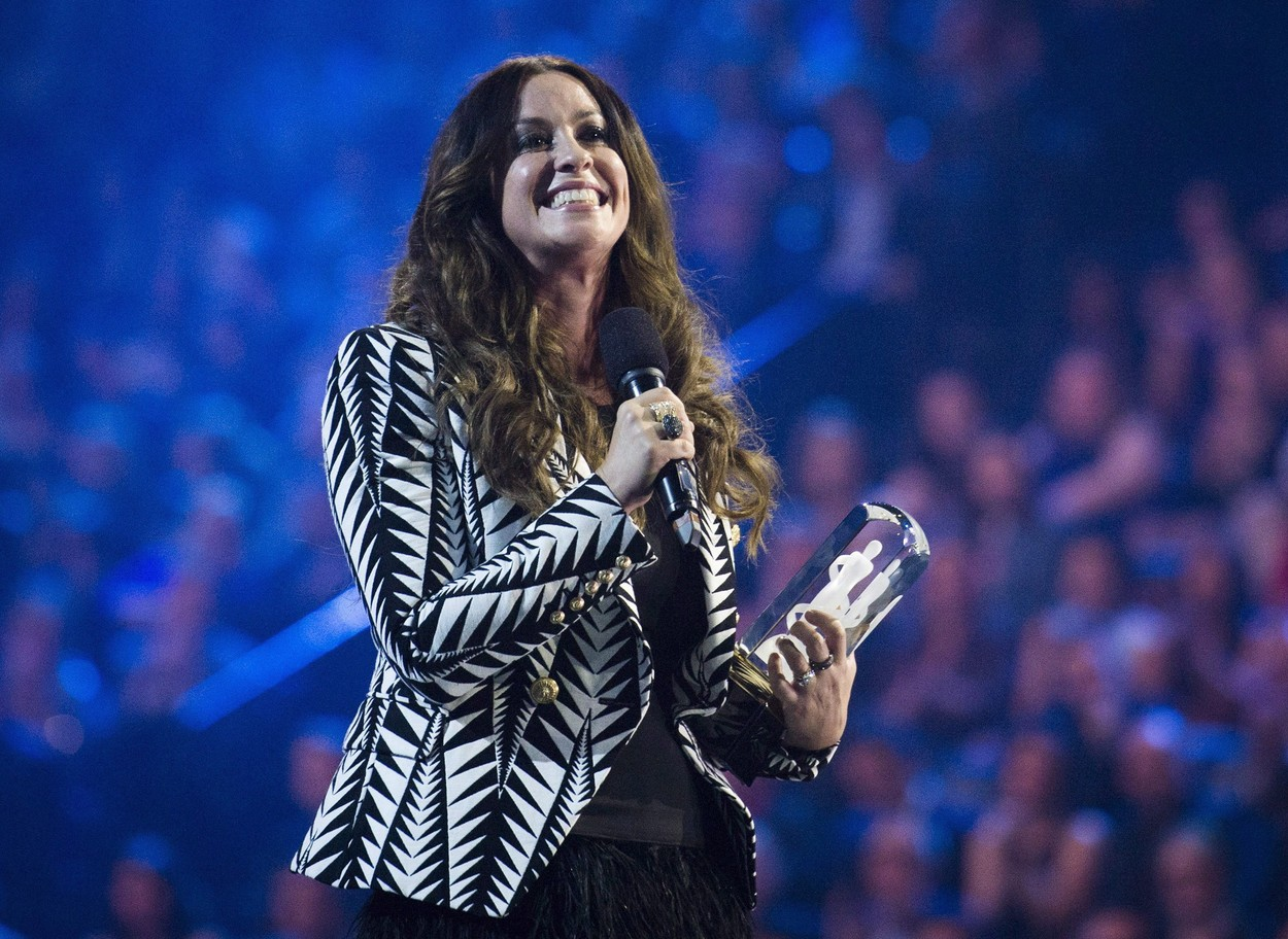March 15, 2015 - Hamilton, on, Canada - Artist Alanis Morissette receives her achievement from the Canadian Music Hall of Fame during the 2015 Juno Awards in Hamilton, Ont., on Sunday, March 15, 2015. The Alanis Morissette musical ''Jagged Little Pill'' is set to debut on Broadway this fall. The show's producers say the hit-driven stage show begins preview performances Nov. 3 and will have its opening night Dec. 5.,Image: 430713682, License: Rights-managed, Restrictions: * Canada and U.S. RIGHTS OUT *, Model Release: no, Credit line: Nathan Denette / Zuma Press / Profimedia