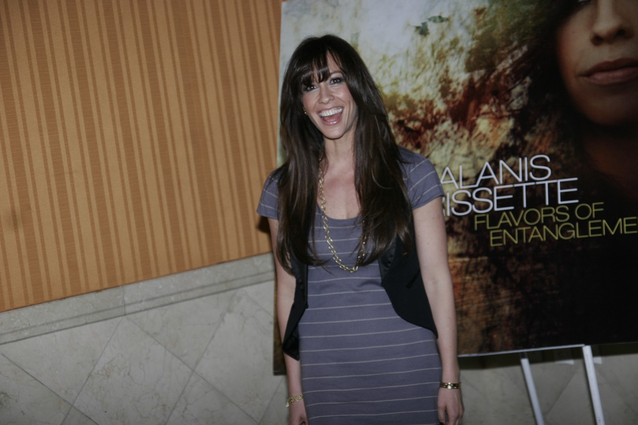 MEXICO CITY, MEXICO - FEB 16: Canadian singer Alanis Morissette poses for photos during the Flavors of entanglement album launchon February 16, 2009,Image: 545349857, License: Rights-managed, Restrictions: Please contact your Local office representative for commercial use. **Mandatory Credit**   **World Rights **, Model Release: no, Credit line: Carlos Tischler / Eyepix / Profimedia
