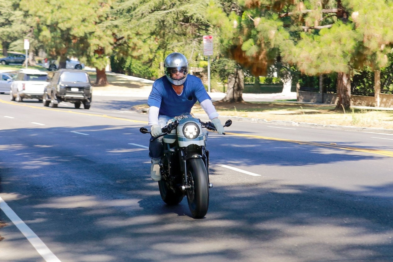 Los Feliz, CA  - Brad Pitt is spotted entering and exiting Angelina Jolie's private community this afternoon on one of his many motorcycles. Brad presumably was stopping by to visit the kids as it has been reported the two have been getting along a lot better lately.  *UK Clients - Pictures Containing Children Please Pixelate Face Prior To Publication*,Image: 547938604, License: Rights-managed, Restrictions: , Model Release: no, Credit line: SL, Terma / BACKGRID / Backgrid USA / Profimedia