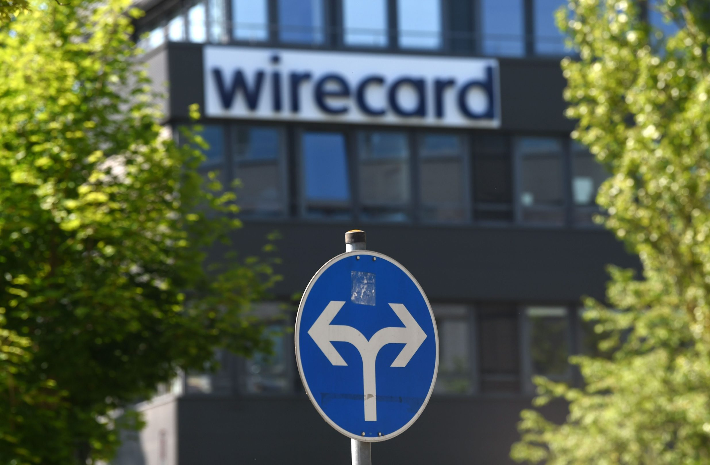 A traffic sign stands in front of the headquarters of German payments provider Wirecard in Aschheim near Munich, southern Germany, on June 24, 2020. - In what could be one of the biggest financial frauds of recent years, German payments provider Wirecard admitted 1.9 billion euros that auditors say are missing from its accounts likely