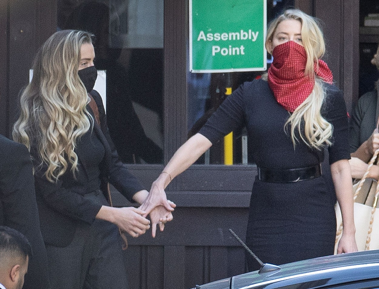 US actor Amber Heard (red facemask) arrives at The High Court in Central London with her sister Whitney Heard. Johnny Depp's libel trial against The Sun newspaper is due to take place over the next three weeks over allegations he was violent and abusive towards his ex-wife Amber Heard. Johnny Depp libel case, London, UK - 07 Jul 2020,Image: 540928461, License: Rights-managed, Restrictions: , Model Release: no, Credit line: Peter MacDiarmid / Shutterstock Editorial / Profimedia