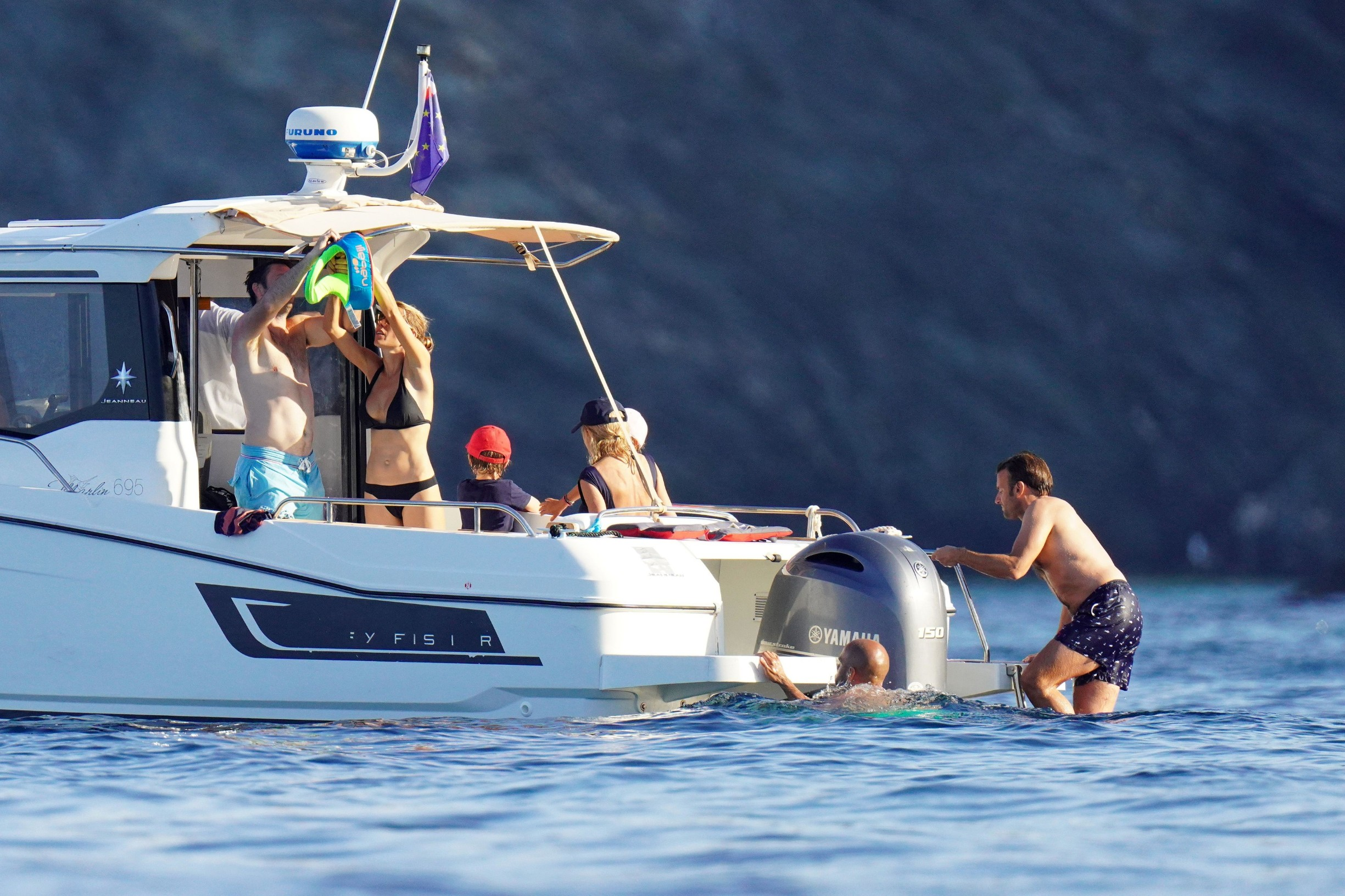 PREMIUM EXCLUSIVE - STRICTLY NO WEB NO BLOG BEFORE THURSDAY 13TH AUGUST 2020 -  French president Emmanuel Macron and wife Brigitte seen enjoying their holiday with their family during a boat day at Porquerolles island in South of France. 01 Aug 2020  The First Lady looks more sculptural than ever.,Image: 551857285, License: Rights-managed, Restrictions: ONLY Australia, Canada, Croatia, Denmark, Greece, Ireland, Israel, Japan, Lithuania, New Zealand, Norway, Poland, Portugal, Romania, Slovakia, Slovenia, South Africa, South Korea, Taiwan, Thailand, Turkey, Ukraine, United Arab Emirates, United Kingdom, United States, Model Release: no, Credit line: MEGA / The Mega Agency / Profimedia