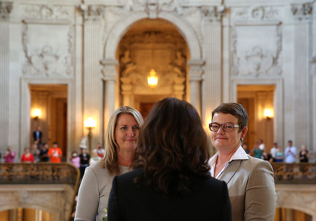 SAN FRANCISCO, CA - JUNE 28:  Same-sex couple Sandy Stier (L) and Kris Perry (R) look on as they are married at San Francisco City Hall by California Attorney General Kamala Harris on June 28, 2013 in San Francisco, California.  The U.S. Ninth Circuit Court of Appeals lifted California's ban on same-sex marriages just three days after the Supreme Court ruled that supporters of the ban, Proposition 8, could not defend it before the high court. California Gov. Jerry Brown ordered all counties in the state to begin issuing licenses immediately. (Photo by Justin Sullivan/Getty Images)