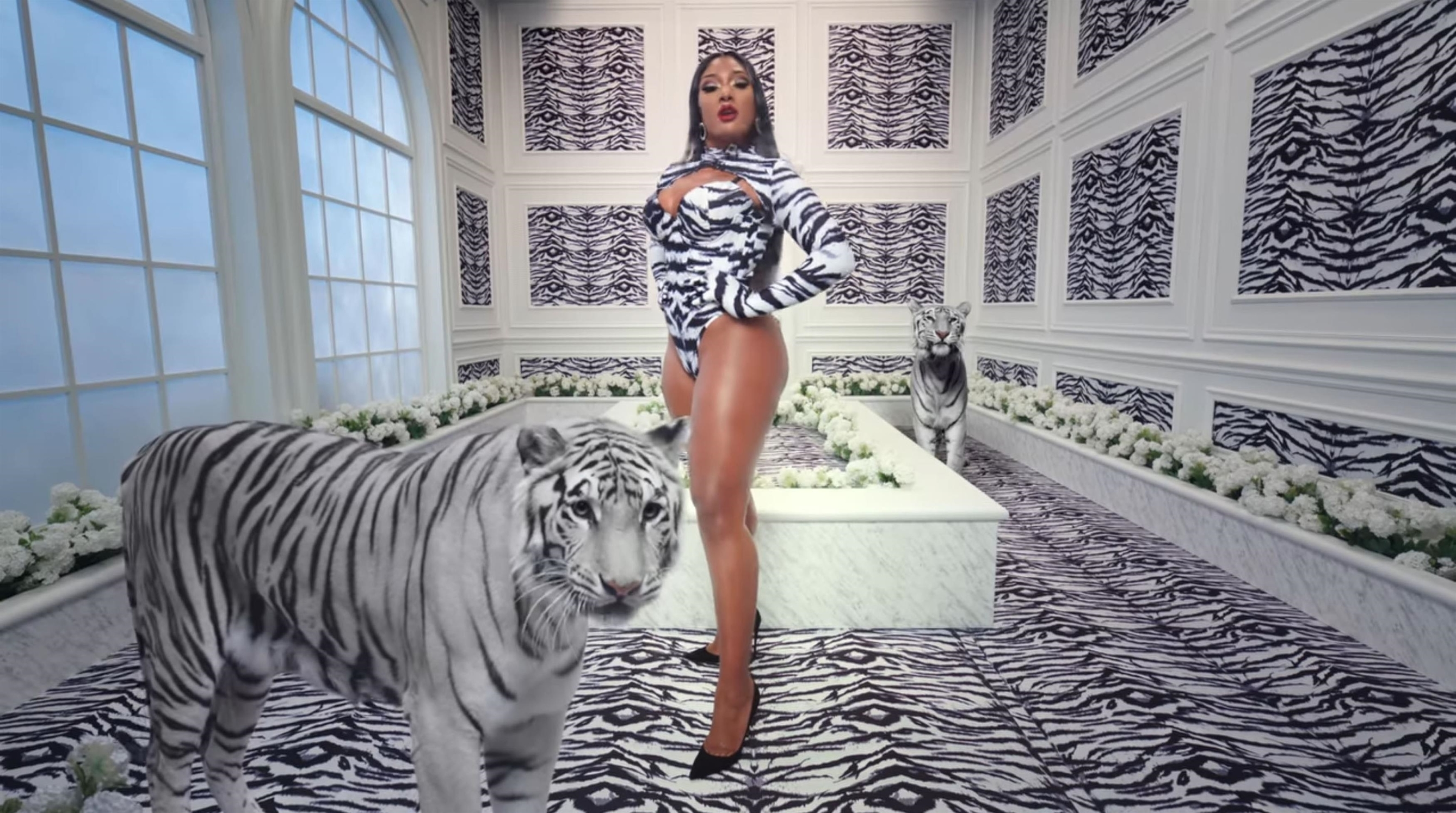 Los Angeles, CA  - Cardi B and Megan Thee Stallion release super raunchy music video for their new single WAP.  The song marks the first joint record between the rap superstars and the track also serves as Cardi's first original release since 2019's Press and arrives as she works on the follow-up to Invasion of Privacy. Cardi, 27, and Megan, 25, sent fans into a meltdown with the release of the music video in which they stunned in a number of barely-there outfits. The video saw the duo splashing around together in a pool as well as writhing around in a sand pit along with several snakes. Cardi also showcased her ample assets in a leopard print outfit that included studded nipple covers while Megan twerked in a barely-there zebra print leotard.  *BACKGRID DOES NOT CLAIM ANY COPYRIGHT OR LICENSE IN THE ATTACHED MATERIAL. ANY DOWNLOADING FEES CHARGED BY BACKGRID ARE FOR BACKGRID'S SERVICES ONLY, AND DO NOT, NOR ARE THEY INTENDED TO, CONVEY TO THE USER ANY COPYRIGHT OR LICENSE IN THE MATERIAL. BY PUBLISHING THIS MATERIAL , THE USER EXPRESSLY AGREES TO INDEMNIFY AND TO HOLD BACKGRID HARMLESS FROM ANY CLAIMS, DEMANDS, OR CAUSES OF ACTION ARISING OUT OF OR CONNECTED IN ANY WAY WITH USER'S PUBLICATION OF THE MATERIAL*  BACKGRID UK 8 AUGUST 2020,Image: 551127636, License: Rights-managed, Restrictions: RIGHTS: WORLDWIDE EXCEPT IN UNITED STATES, Model Release: no, Credit line: Atlantic Records / BACKGRID / Backgrid UK / Profimedia