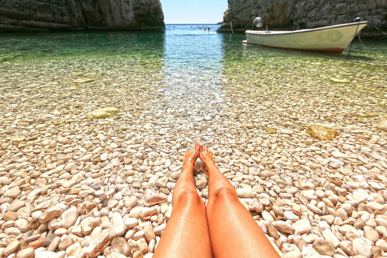 Woman relaxing on idyllic Dalmatian beach Stiniva