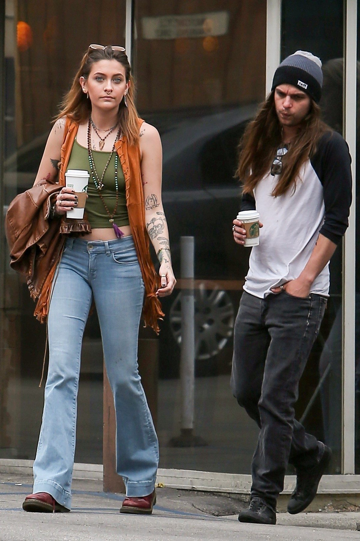 West Hollywood, CA  - *EXCLUSIVE*  - Paris Jackson looks to be in good spirits as she cozies up to new boyfriend Gabriel Glenn on a Starbucks coffee run with a friend on Sunset Strip in West Hollywood. The lovely actress shows off her new Led Zeppelin tattoo as she returns to her Jeep with a smile.  Pictured: Paris Jackson, Gabriel Glenn    *UK Clients - Pictures Containing Children Please Pixelate Face Prior To Publication*,Image: 411707494, License: Rights-managed, Restrictions: , Model Release: no, Credit line: BACKGRID / Backgrid USA / Profimedia