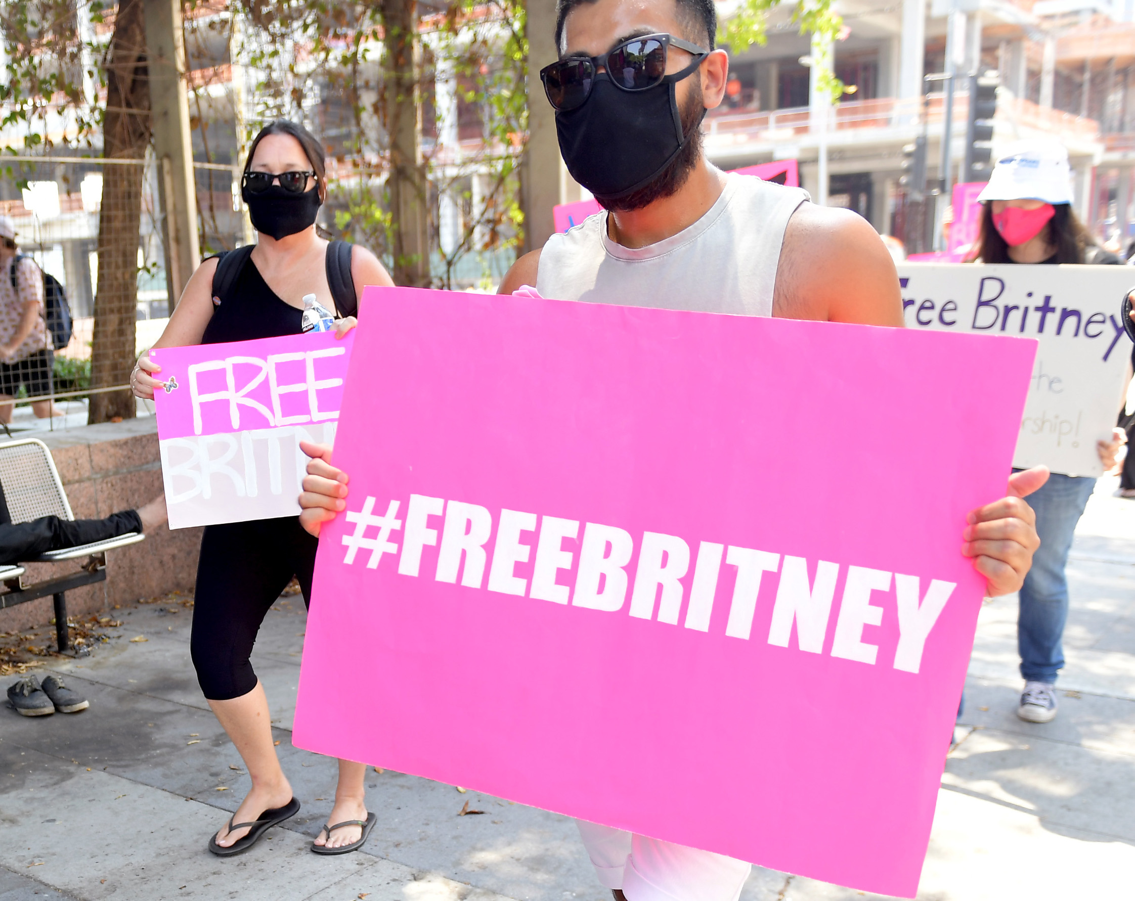 LOS ANGELES, CALIFORNIA - AUGUST 19: Supporters of Britney Spears gather outside a courthouse in downtown for a #FreeBritney protest as a hearing regarding Spears' conservatorship is in session on August 19, 2020 in Los Angeles, California. Spears was placed in a conservatorship managed by her father, James Spears, and an attorney following her involuntary hospitalization for mental care in 2008. (Photo by Matt Winkelmeyer/Getty Images)