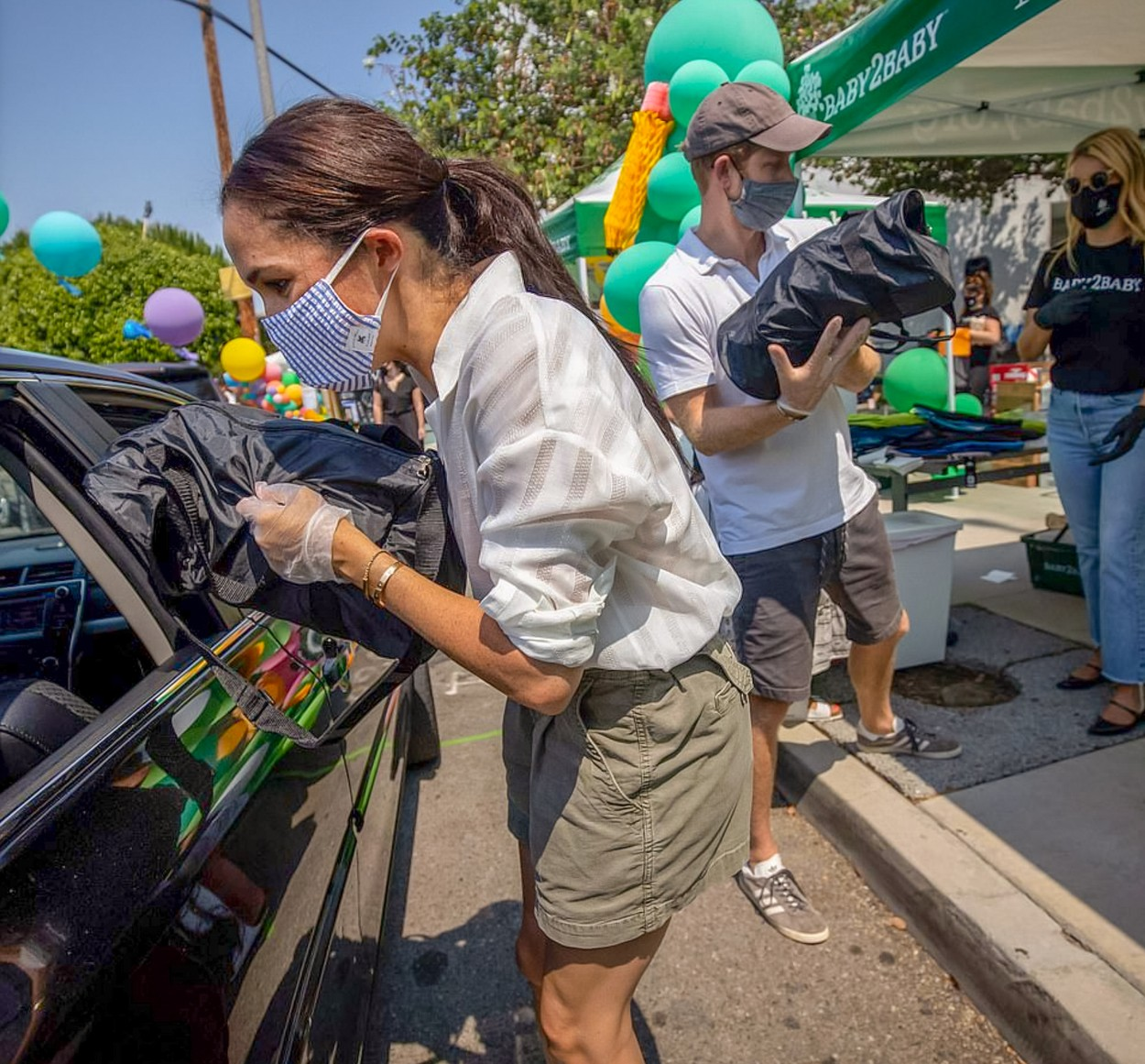 Photo © 2020: Baby2Baby via The Grosby Group  Los Angeles, August 19, 2020.  Prince Harry and Meghan Markle volunteered at a charity event to distribute supplies and clothes to families in need for back to school. The event was a drive though at Dr. Owen Lloyd Knox Elementary School in South Los Angeles and the couple gave the items to the families through the windows of the cars, while wearing masks and gloves. The event was organized by the charity organization, Baby2Baby.   DISCLAIMER:  Please note: The Grosby Group does not claim any ownership including but not limited to Copyright or License in the attached material. Fees charged by The Grosby Group are for The Grosby Group's services only, and do not, nor are they intended to, convey to the user any ownership of Copyright or License in the material. By publishing this material you expressly agree to indemnify and to hold The Grosby Group and its directors, shareholders and employees harmless from any loss, claims, damages, demands, expenses (including legal fees), or any causes of action or allegation against The Grosby Group arising out of or connected in any way with publication of the material.,Image: 554377297, License: Rights-managed, Restrictions: , Model Release: no, Credit line: Baby2Baby via The Grosby Group / Grosby Group / Profimedia