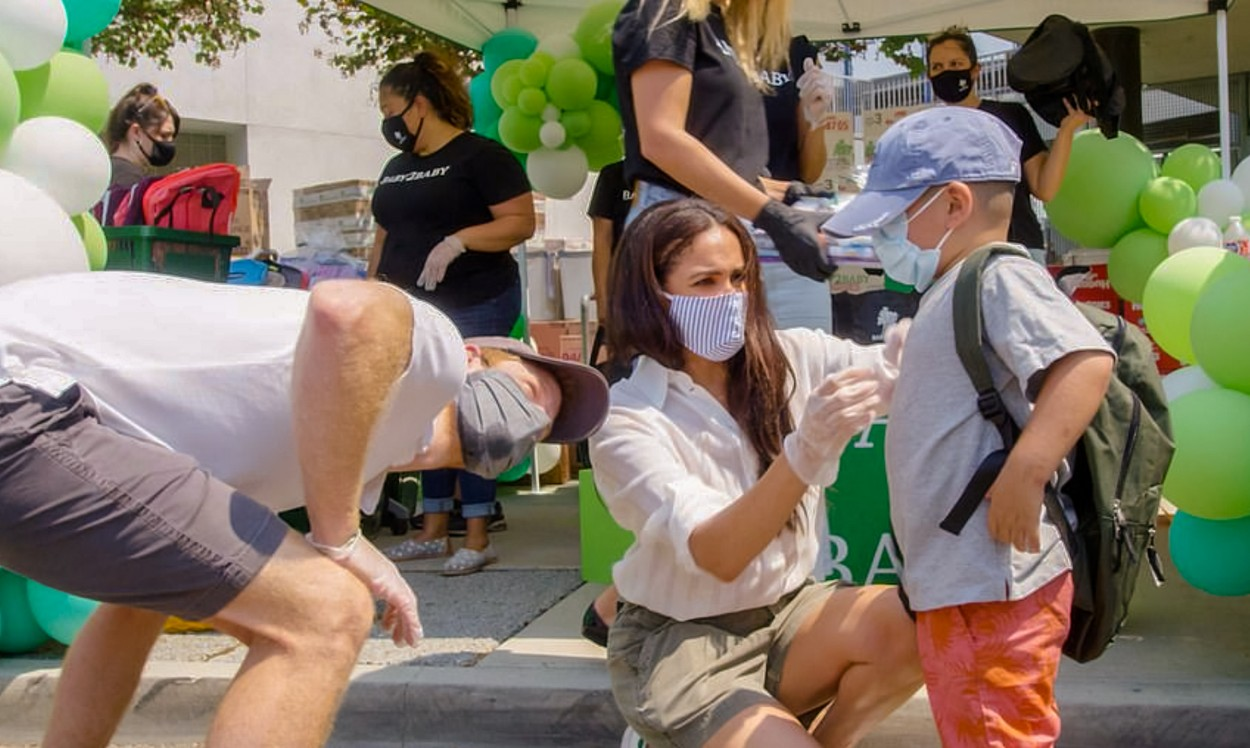 Photo © 2020: Baby2Baby via The Grosby Group  Los Angeles, August 19, 2020.  Prince Harry and Meghan Markle volunteered at a charity event to distribute supplies and clothes to families in need for back to school. The event was a drive though at Dr. Owen Lloyd Knox Elementary School in South Los Angeles and the couple gave the items to the families through the windows of the cars, while wearing masks and gloves. The event was organized by the charity organization, Baby2Baby.   DISCLAIMER:  Please note: The Grosby Group does not claim any ownership including but not limited to Copyright or License in the attached material. Fees charged by The Grosby Group are for The Grosby Group's services only, and do not, nor are they intended to, convey to the user any ownership of Copyright or License in the material. By publishing this material you expressly agree to indemnify and to hold The Grosby Group and its directors, shareholders and employees harmless from any loss, claims, damages, demands, expenses (including legal fees), or any causes of action or allegation against The Grosby Group arising out of or connected in any way with publication of the material.,Image: 554377306, License: Rights-managed, Restrictions: , Model Release: no, Credit line: Baby2Baby via The Grosby Group / Grosby Group / Profimedia