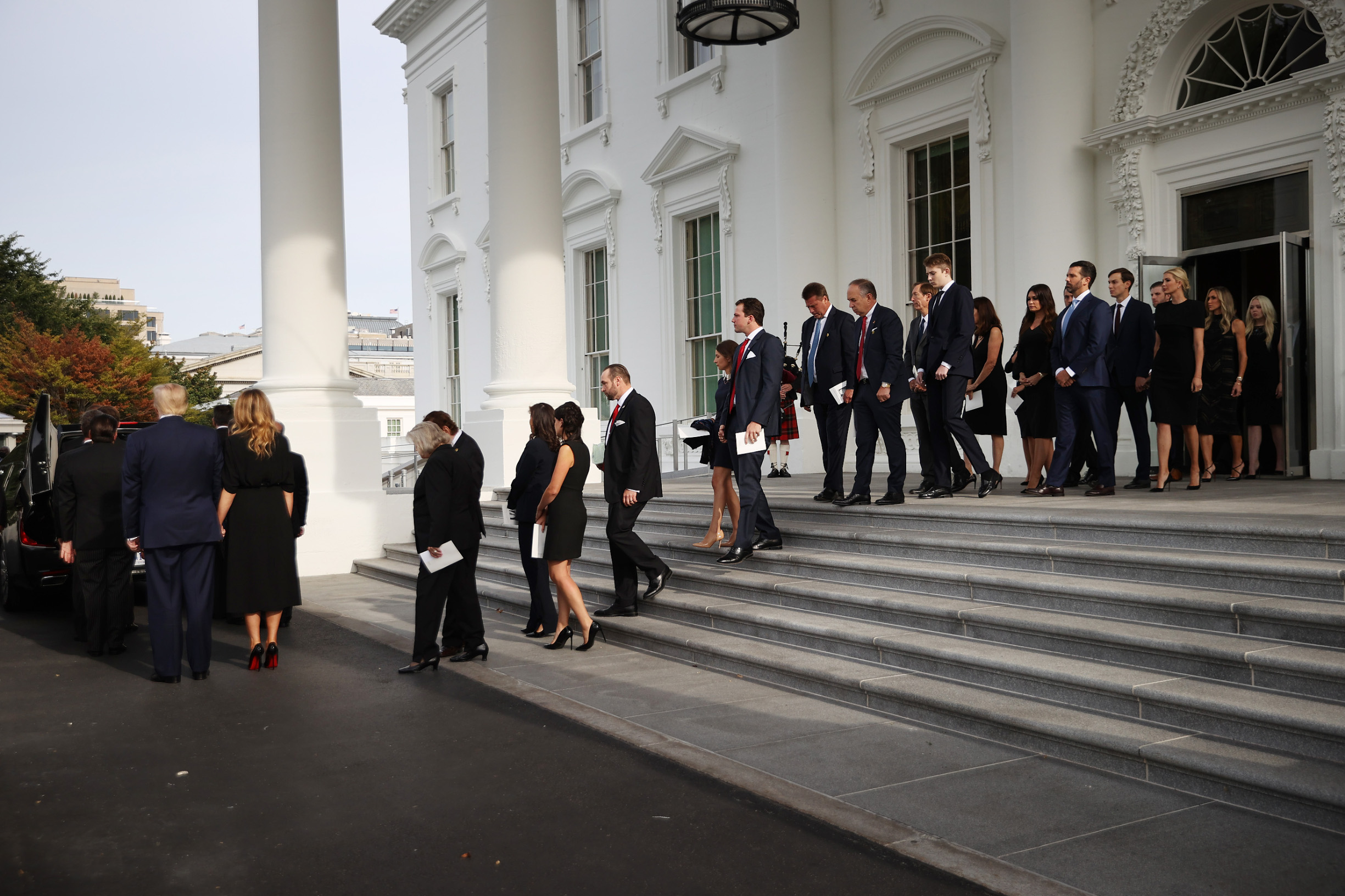 """WASHINGTON, DC - AUGUST 21: U.S. President Donald Trump (L) and First Lady Melania Trump are joined by members of the Trump family as Robert Trump's casket is loaded into a hearse at the North Portico of the White House following his funeral service on August 21, 2020 in Washington, DC. Robert Trump passed away on August 15 at the age of 71. In a statement, President Trump wrote, """"He was not just my brother, he was my best friend."""