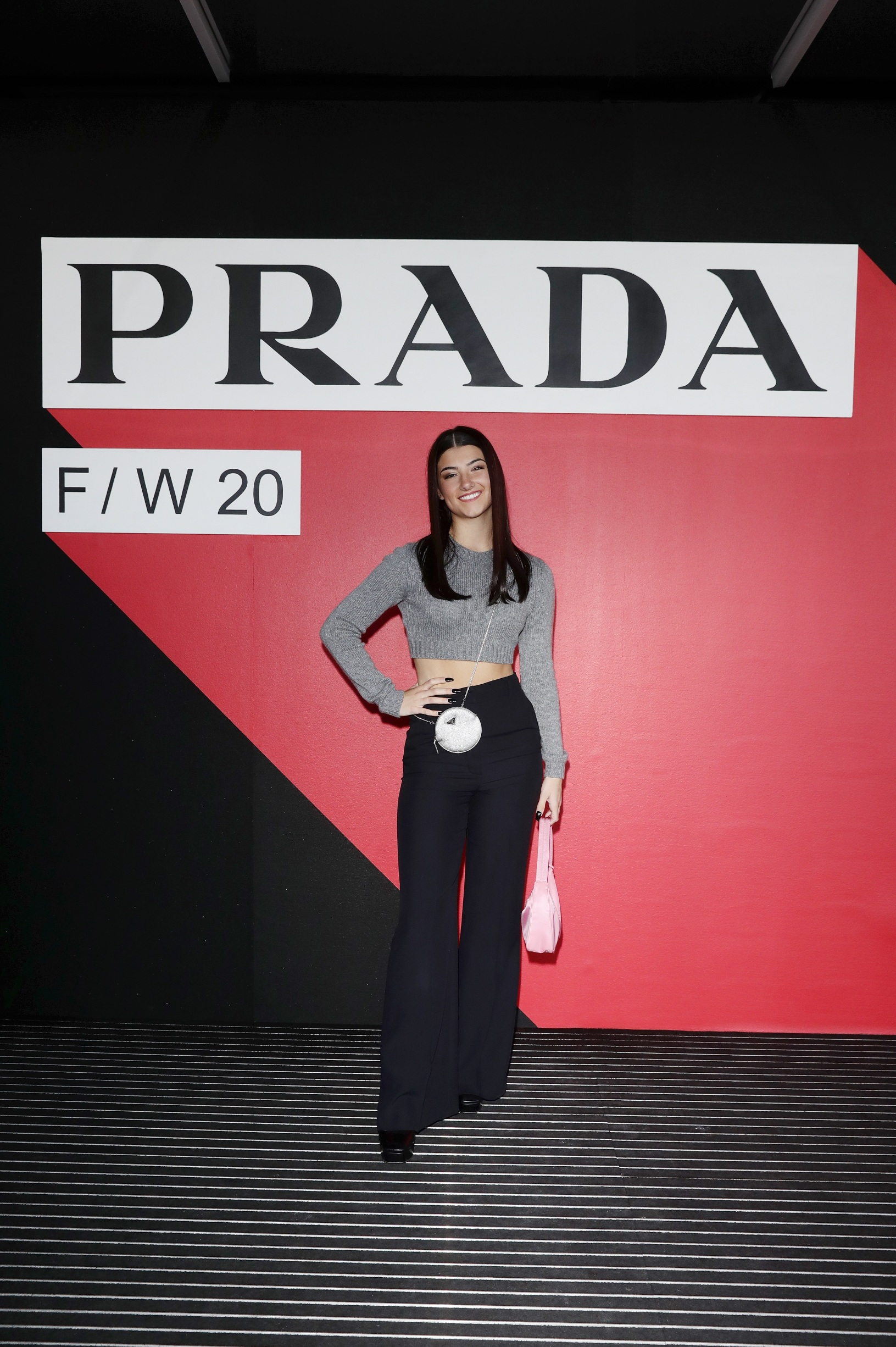 MILAN, ITALY - FEBRUARY 20: Charli D'Amelio attends the Prada show during Milan Fashion Week Fall/Winter 2020/2021 on February 20, 2020 in Milan, Italy. (Photo by Vittorio Zunino Celotto/Getty Images for Prada)