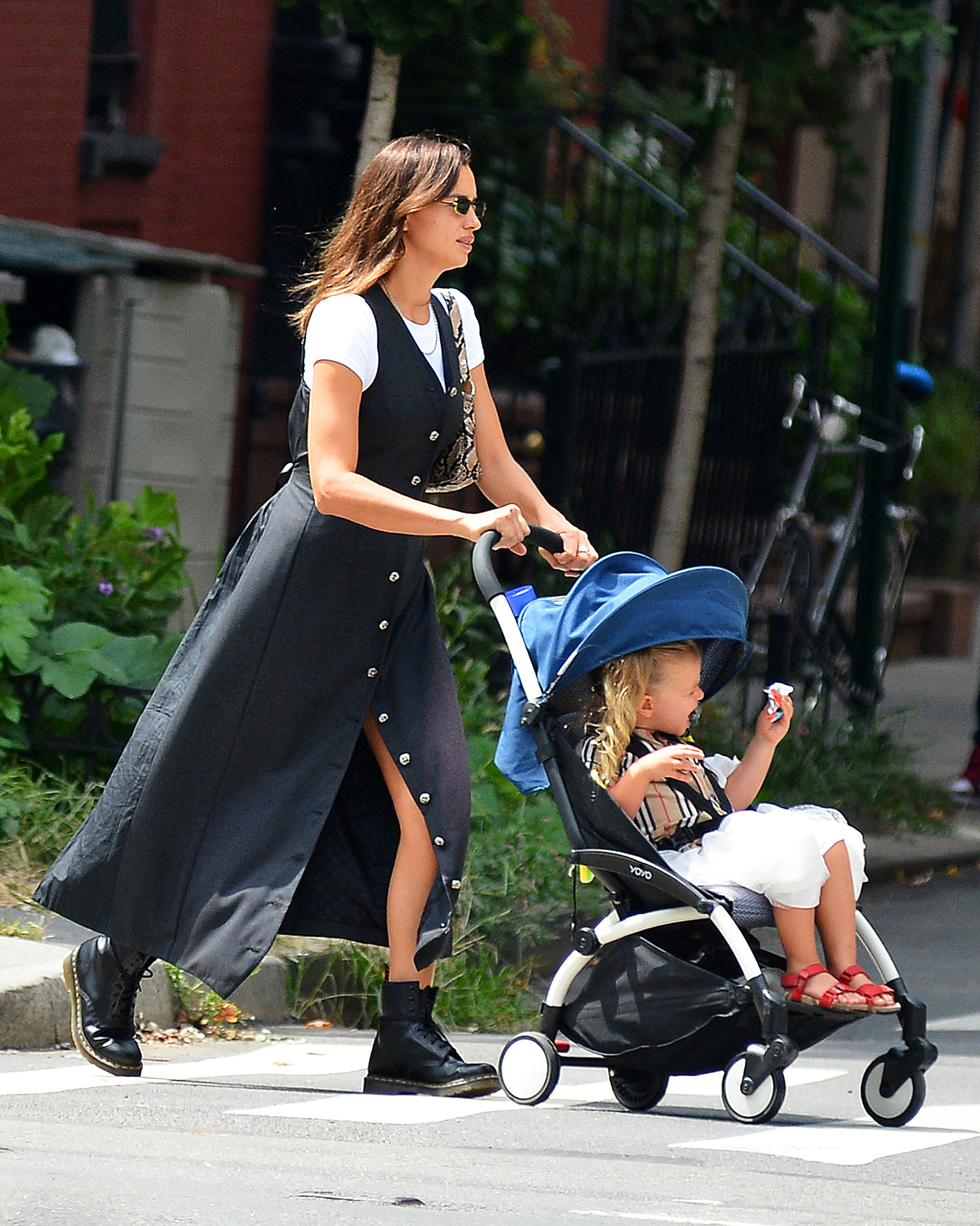 08/21/2020 EXCLUSIVE: Irina Shayk Steps Out With Her Daughter in New York City. The 34 year old model looked casual in a long black dress over a white tee shirt and black Doc Marten boots,Image: 554486310, License: Rights-managed, Restrictions: Exclusive NO usage without agreed price and terms. Please contact sales@theimagedirect.com, Model Release: no, Credit line: TheImageDirect.com / The Image Direct / Profimedia
