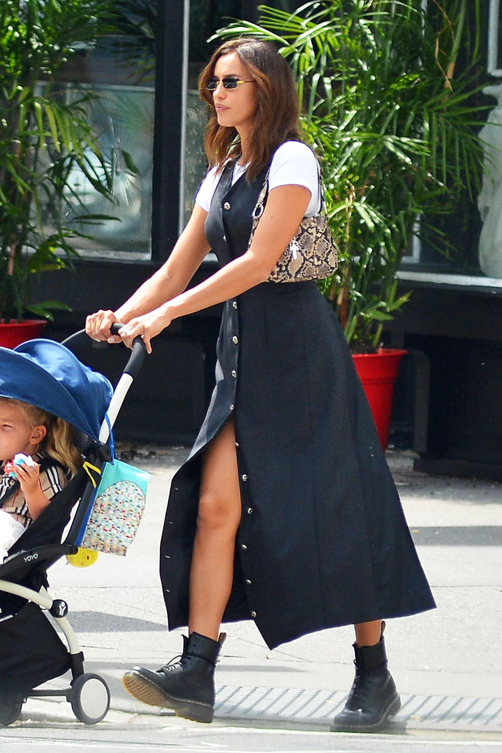 08/21/2020 EXCLUSIVE: Irina Shayk Steps Out With Her Daughter in New York City. The 34 year old model looked casual in a long black dress over a white tee shirt and black Doc Marten boots,Image: 554486327, License: Rights-managed, Restrictions: Exclusive NO usage without agreed price and terms. Please contact sales@theimagedirect.com, Model Release: no, Credit line: TheImageDirect.com / The Image Direct / Profimedia